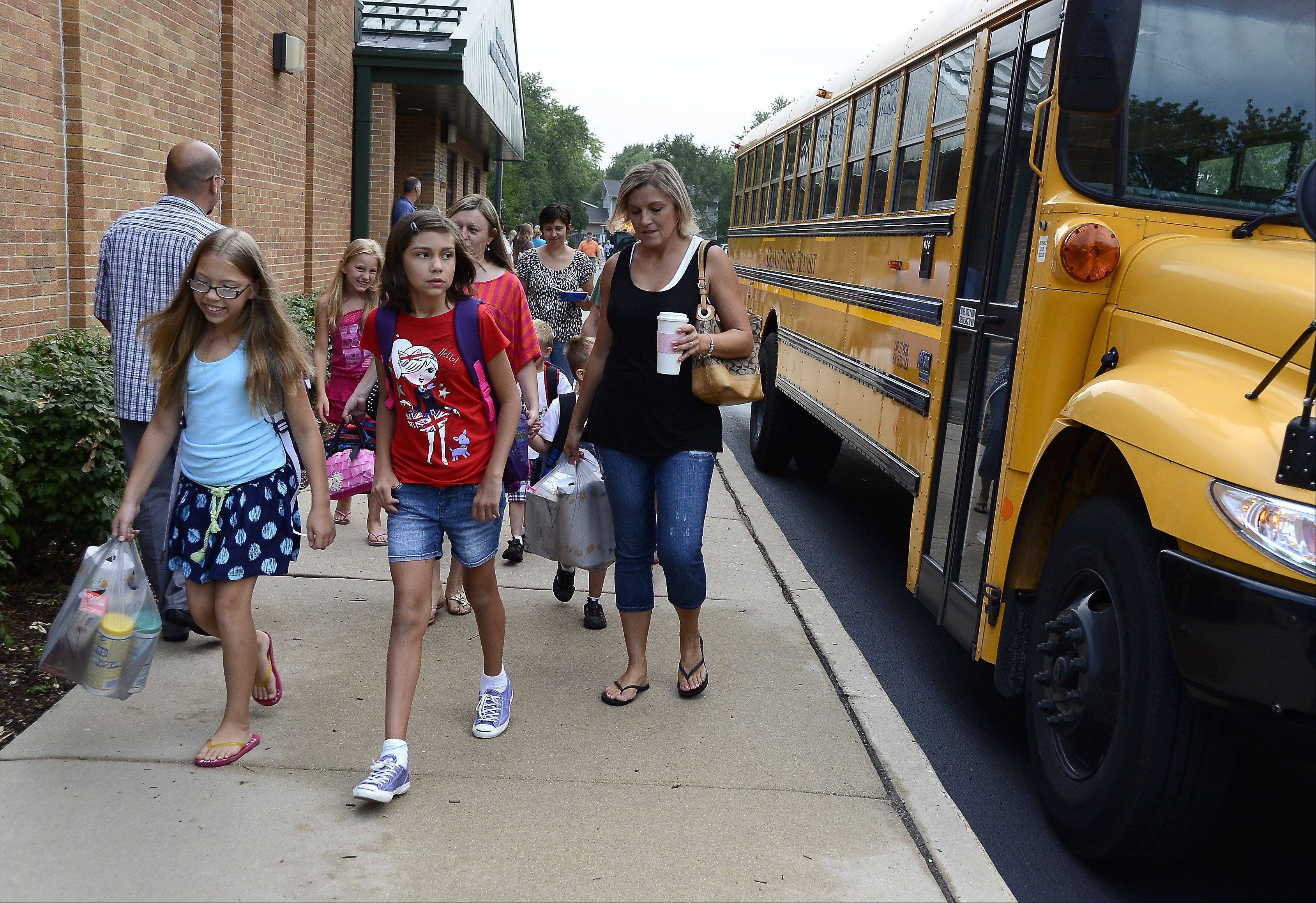 Parents take their children back for the first day of classes at Ridge Family Center for Learning.