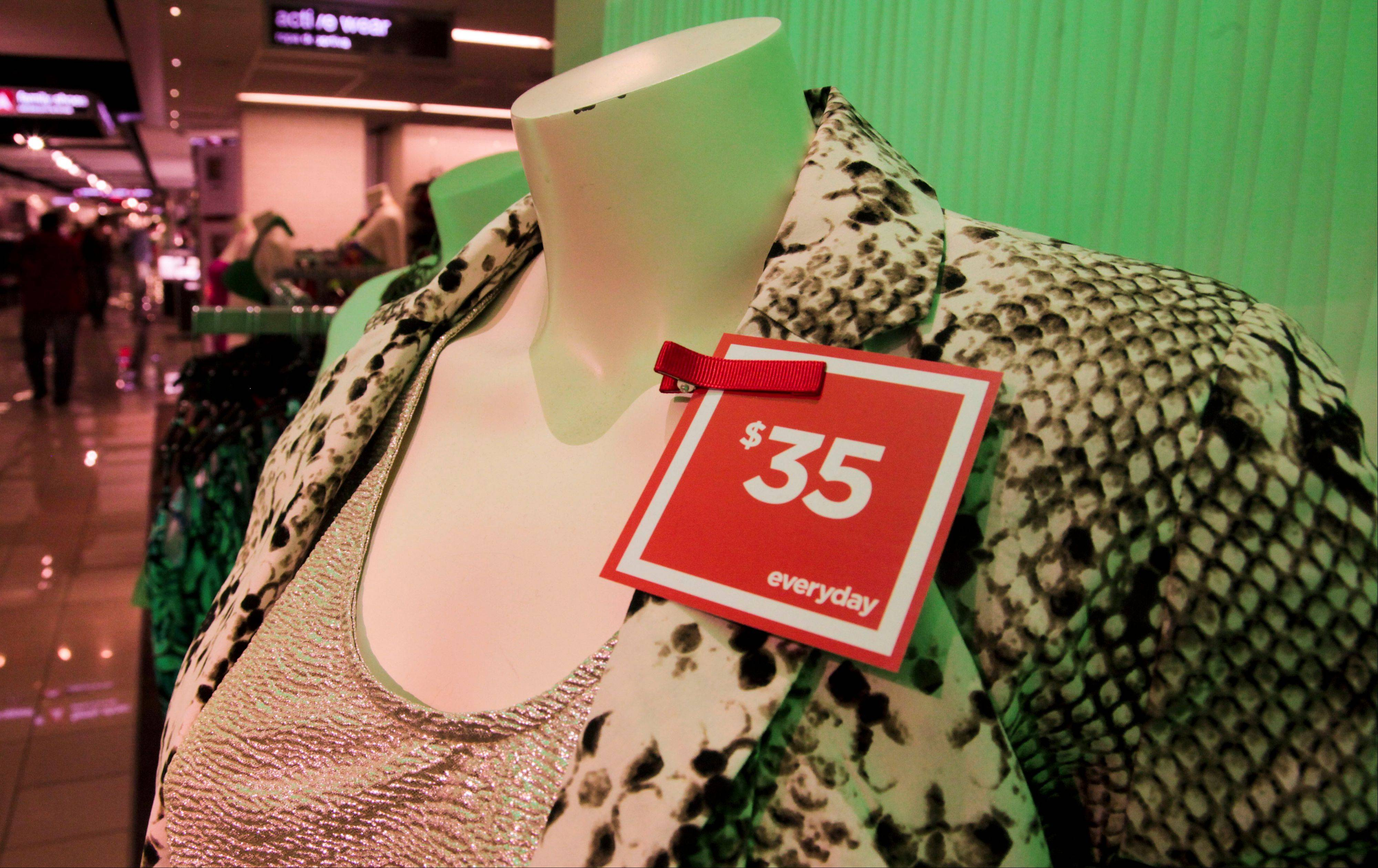 A red �everyday� pricing tag is attached to clothes on display at a J.C. Penney store in New York. Six months after J.C. Penney got rid of the hundreds of sales it offers each year in favor of a three-tier pricing approach, the mid-priced department store chain is revamping its pricing strategy again.