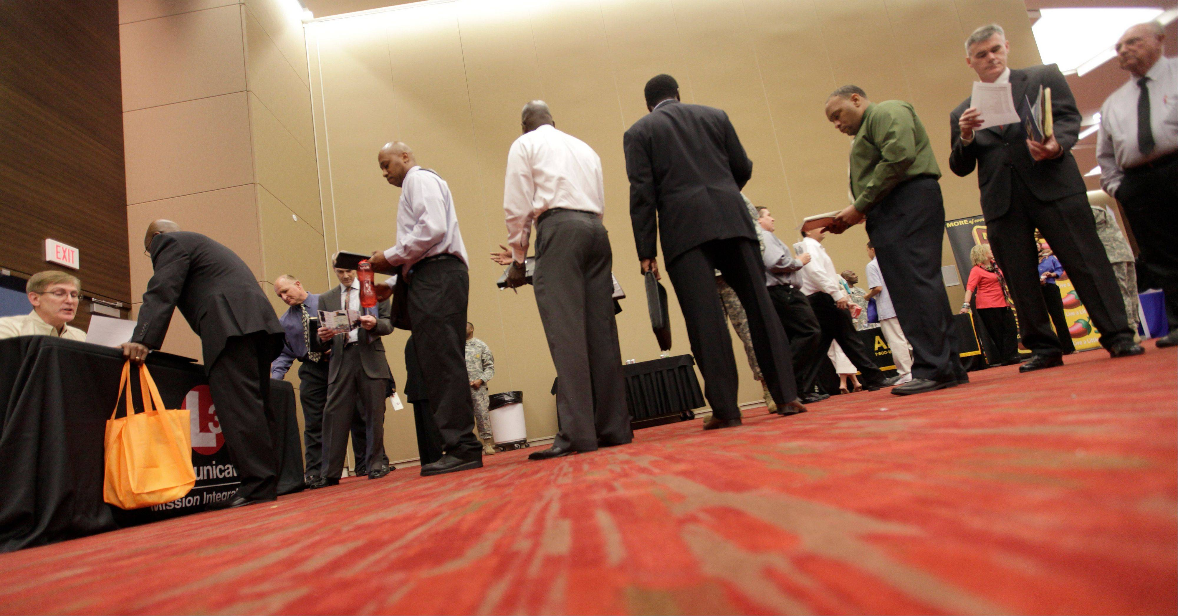 Job seekers line up to speak to a recruiter during a job fair in Irving, Texas.