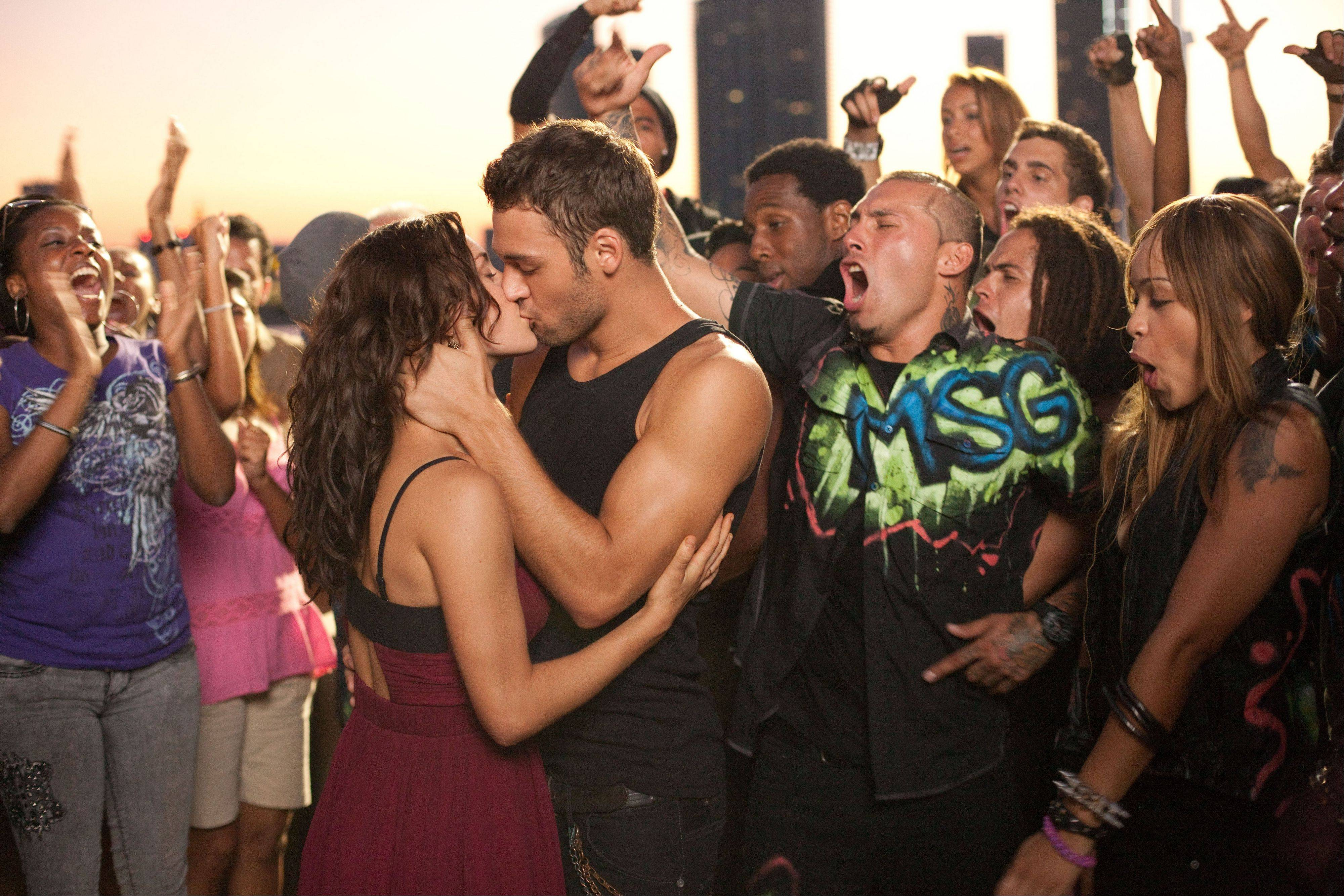 "Romantic sparks fly between dancers Emily (Kathryn McCormick), left, and Sean (Ryan Guzman) in ""Step Up Revolution."""