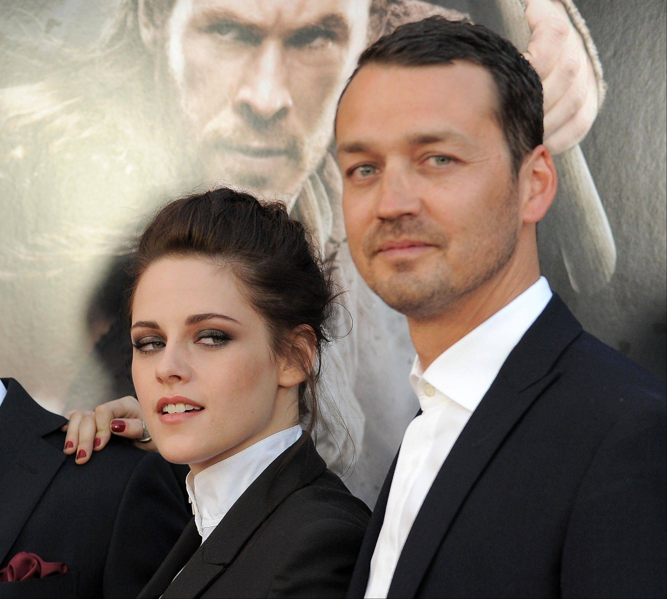 "FILE - This May 29, 2012 file photo shows actress Kristen Stewart and director Rupert Sanders attending the ""Snow White and the Huntsman"" screening in Los Angeles. Stewart and director Rupert Sanders are apologizing publicly to their loved ones following reports of infidelity. The 22-year-old actress and the 41-year-old filmmaker issued separate apologies to People magazine Wednesday, July 25, saying they regret the hurt they have caused. Stewart has been in a relationship for several years with her �Twilight� co-star Robert Pattinson. Sanders is married and has two children. (Photo by Jordan Strauss/Invision/AP)"