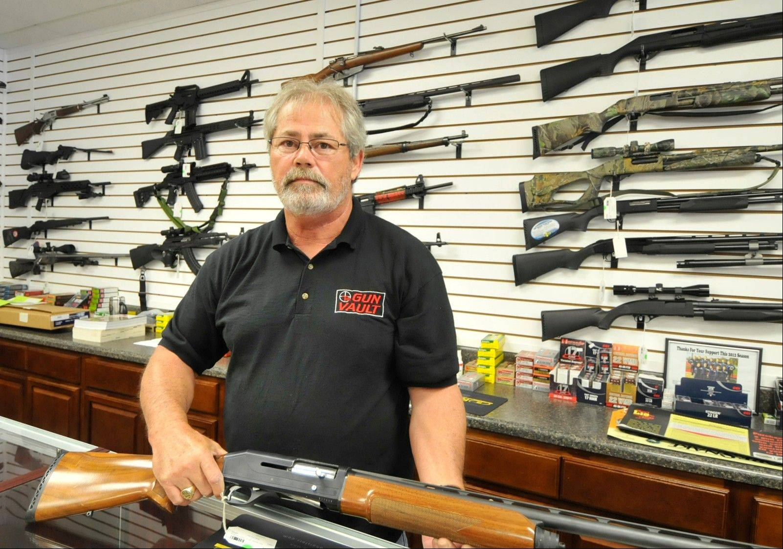 Randy Hodges holds a firearm at the Gun Vault in High Point, N.C., Monday. Issues of gun sales, especially assault rifles and large amounts of ammunition, surfaced after the Aurora, Colo., theater shootings a week ago. But little is expected to happen.