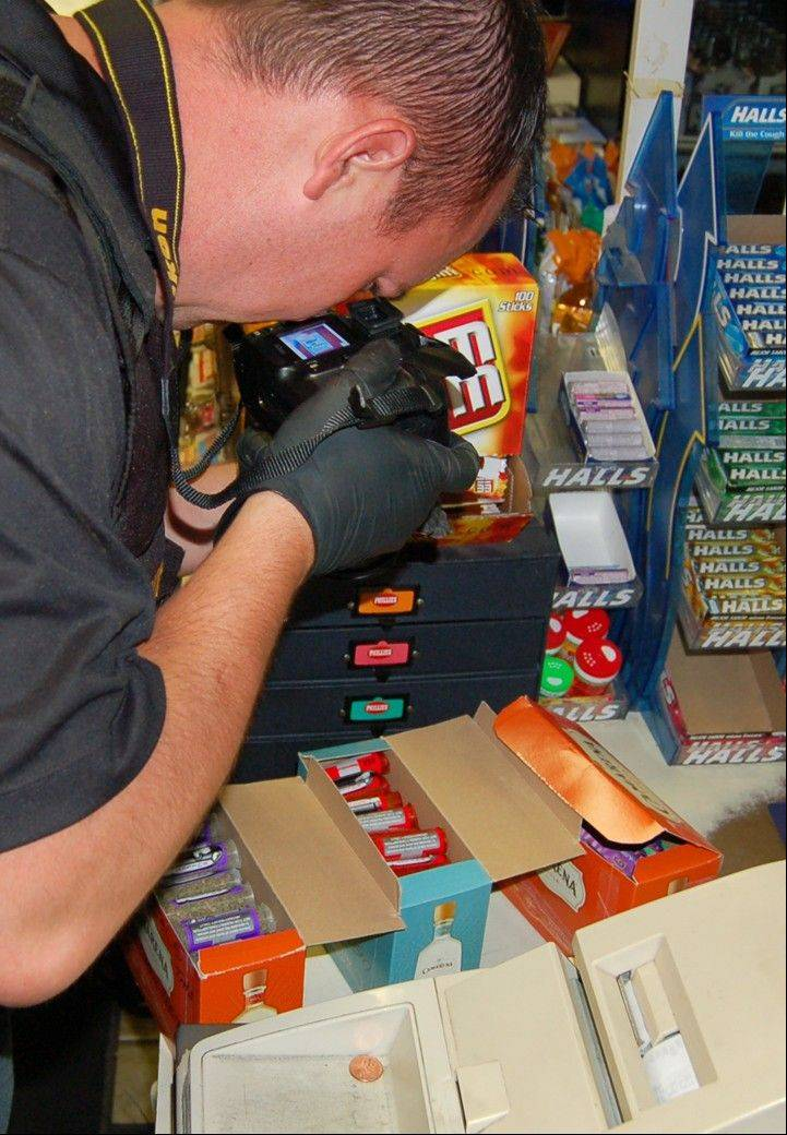 A Lake County sheriff�s deputy inspects packages of synthetic cannabis at 41 News in Wadsworth on Thursday as part of a three-month investigation into the distribution of synthetic cannabis in Lake County.
