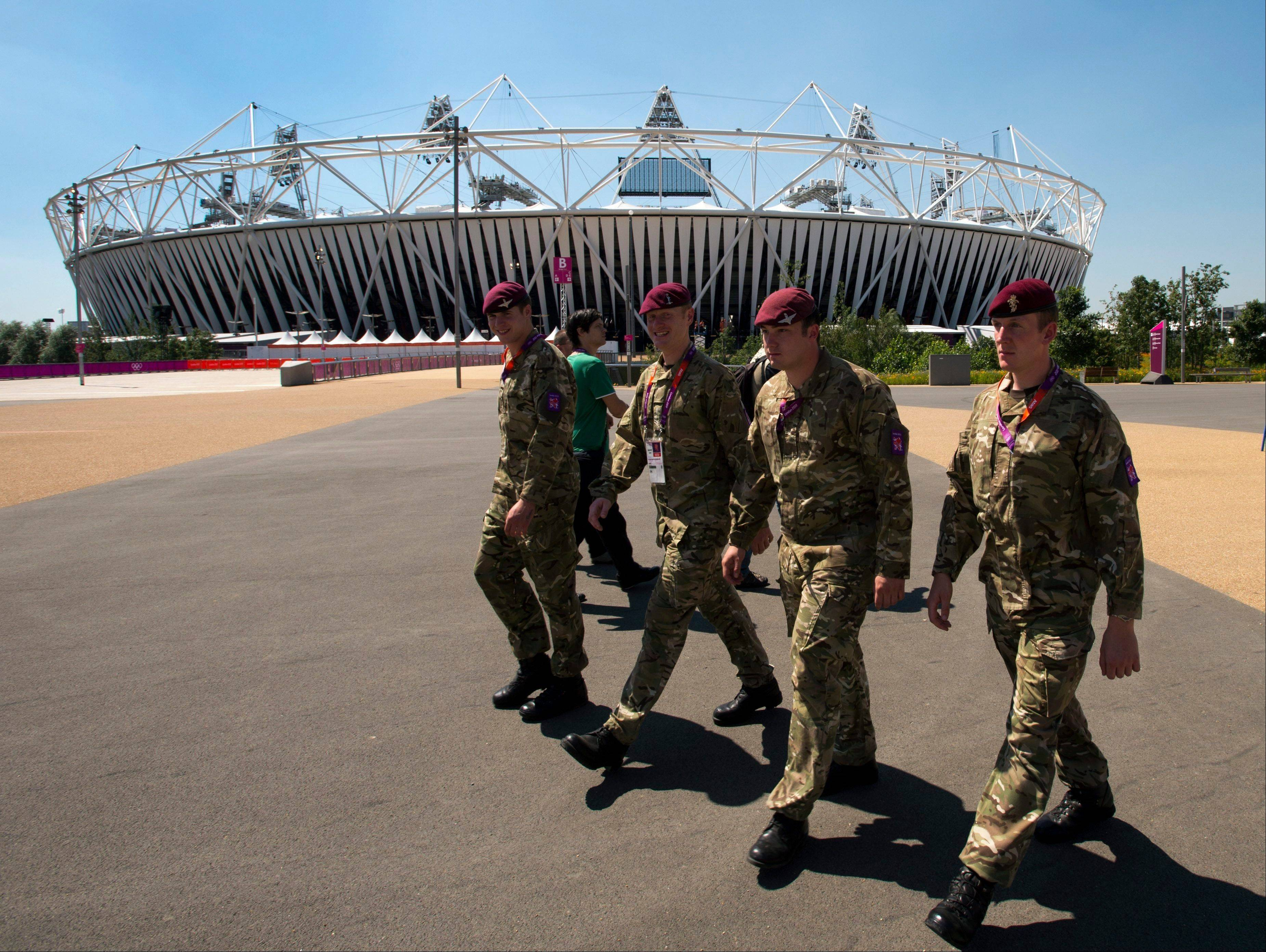 British soldiers walk past the Olympic stadium as preparations continue for the 2012 Summer Olympics earlier this week in London.