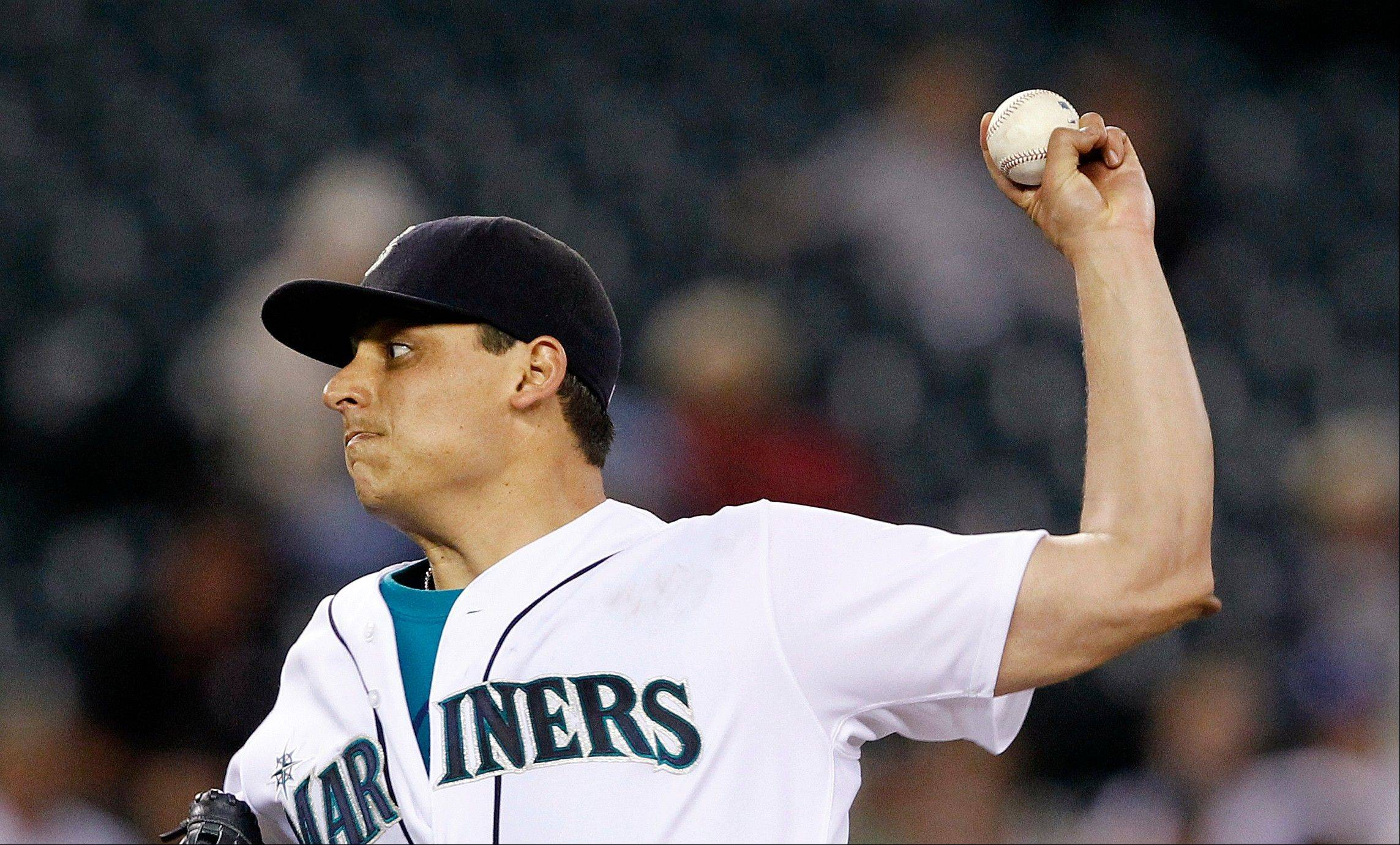 Seattle Mariners starting pitcher Jason Vargas retired the first 11 batters he faced at home against Kansas City on Thursday.