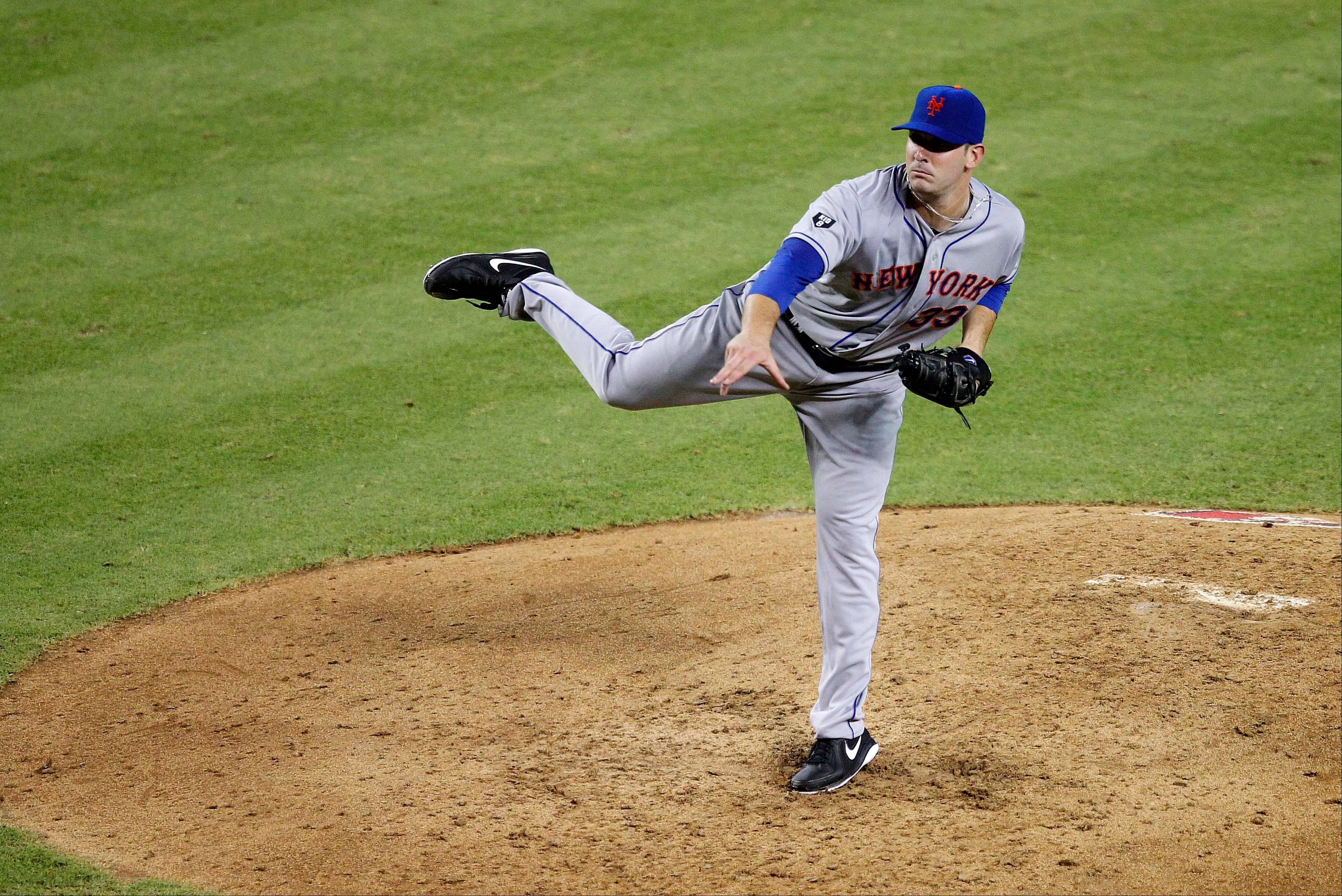 Mets pitcher Matt Harvey delivers in his major league debut during the fifth inning Thursday in Phoenix. He held the Diamondbacks to three hits.