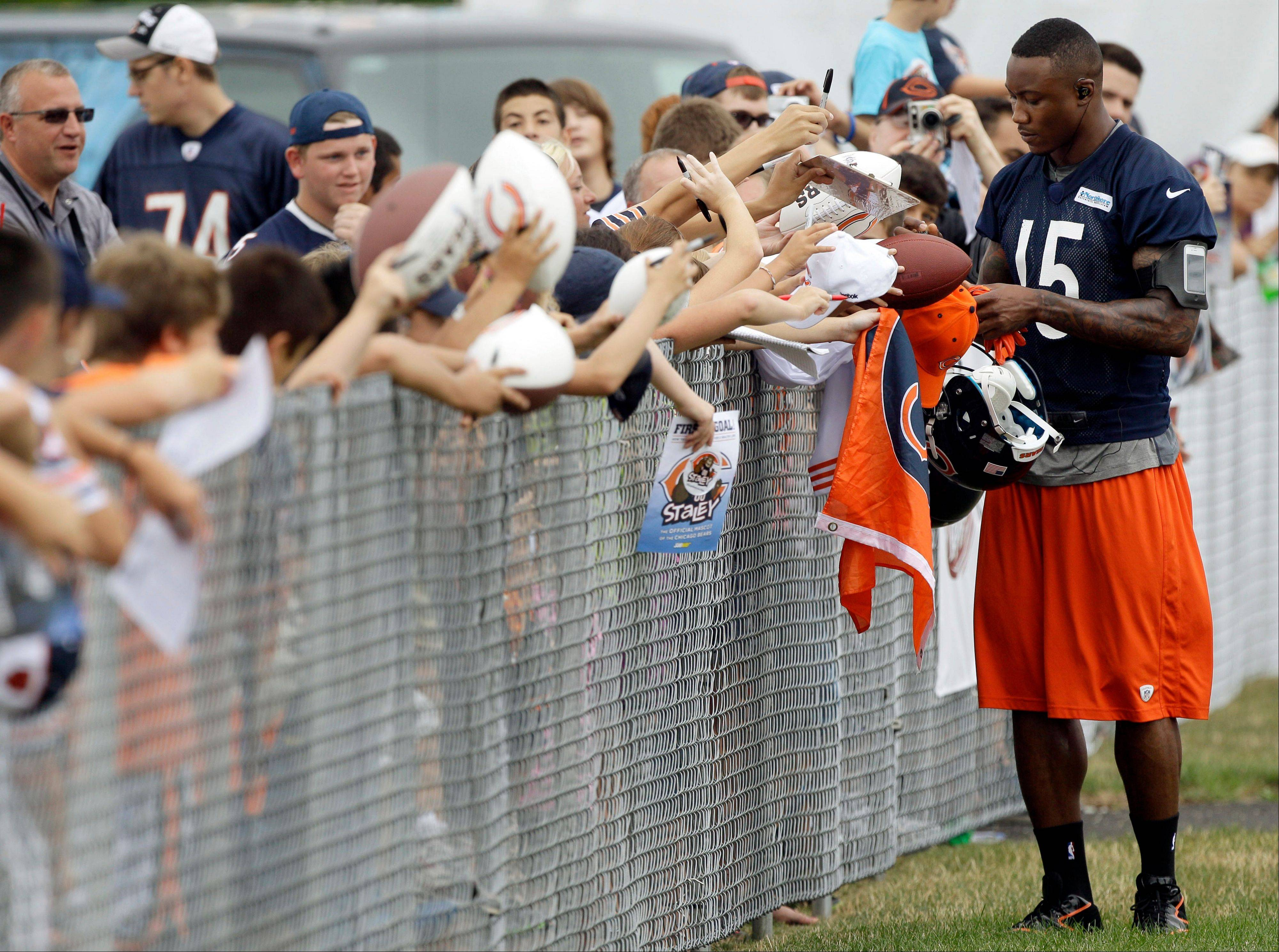 Bears wide receiver Brandon Marshall signs autographs Thursday at Olivet Nazarene University.