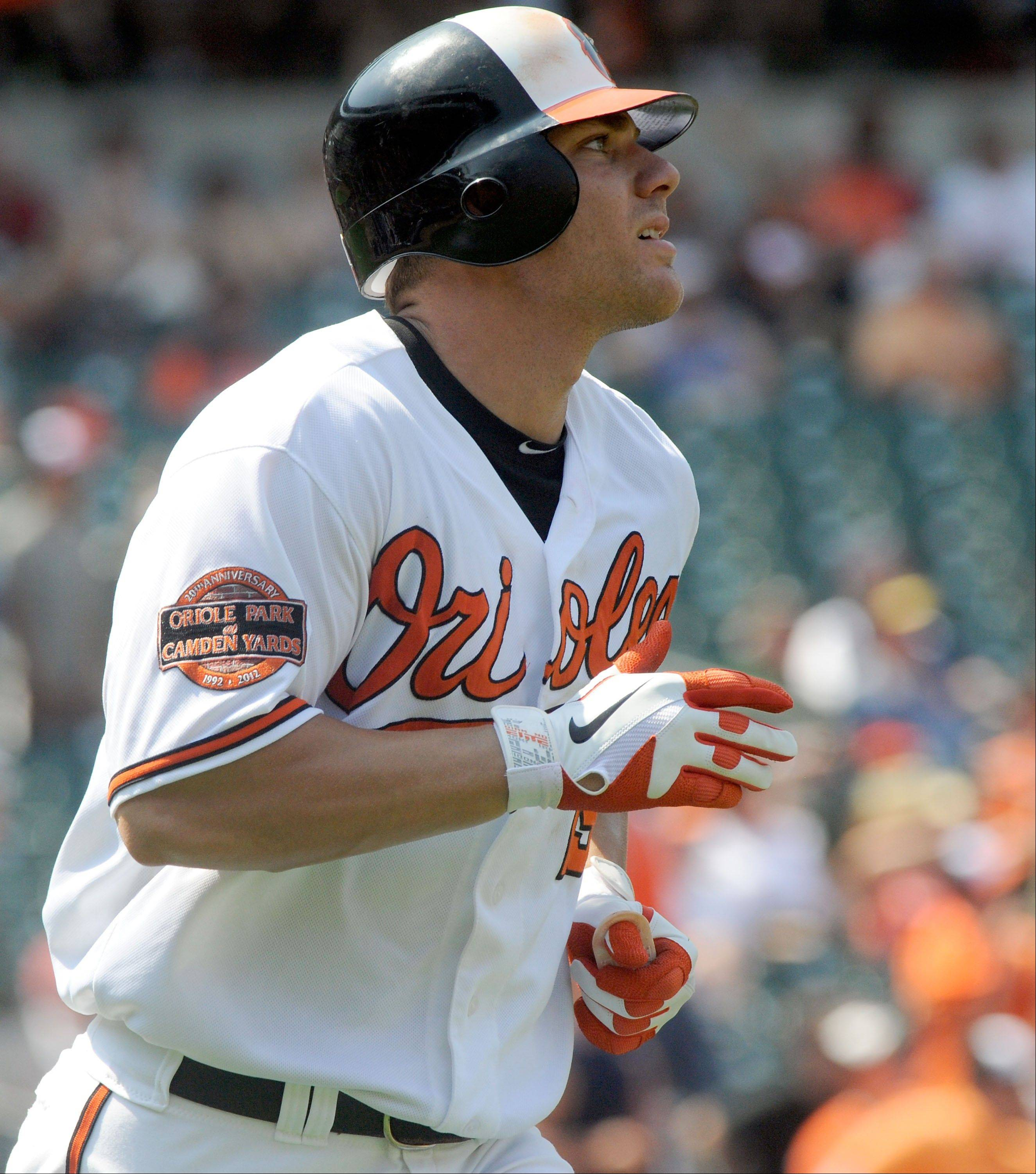 The Baltimore Orioles� Chris Davis watches his solo home run Thursday during the eighth inning against the Tampa Bay Rays in Baltimore. The Orioles won 6-2.