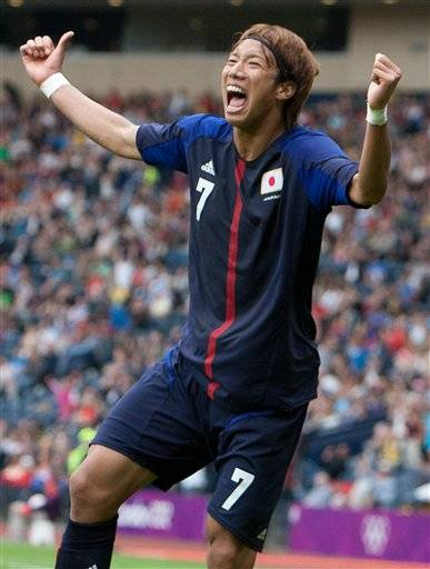 Japan's Yuki Otsu celebrates after scoring the only goal during the group D men's soccer match between Japan and Spain at the London 2012 Summer Olympics, Thursday