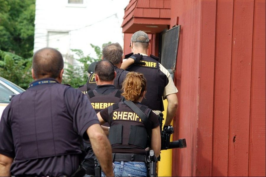 Lake County sheriff's deputies enter 41 News in Wadsworth Thursday to conduct a search as part of a three-month investigation into the distribution of synthetic cannabis in Lake County.