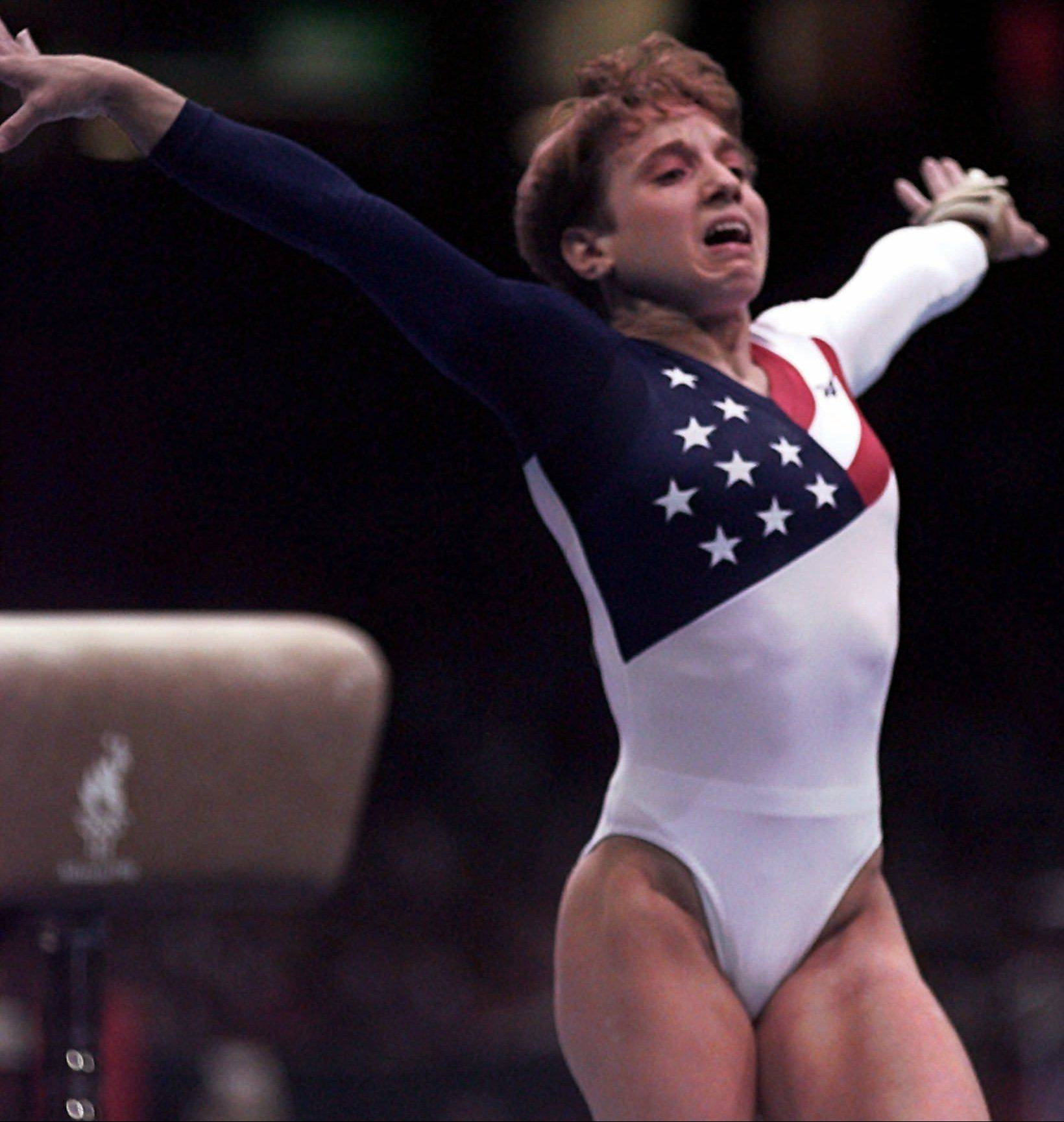 Kerri Strug injured her left leg during the landing of her vault routine in Atlanta.