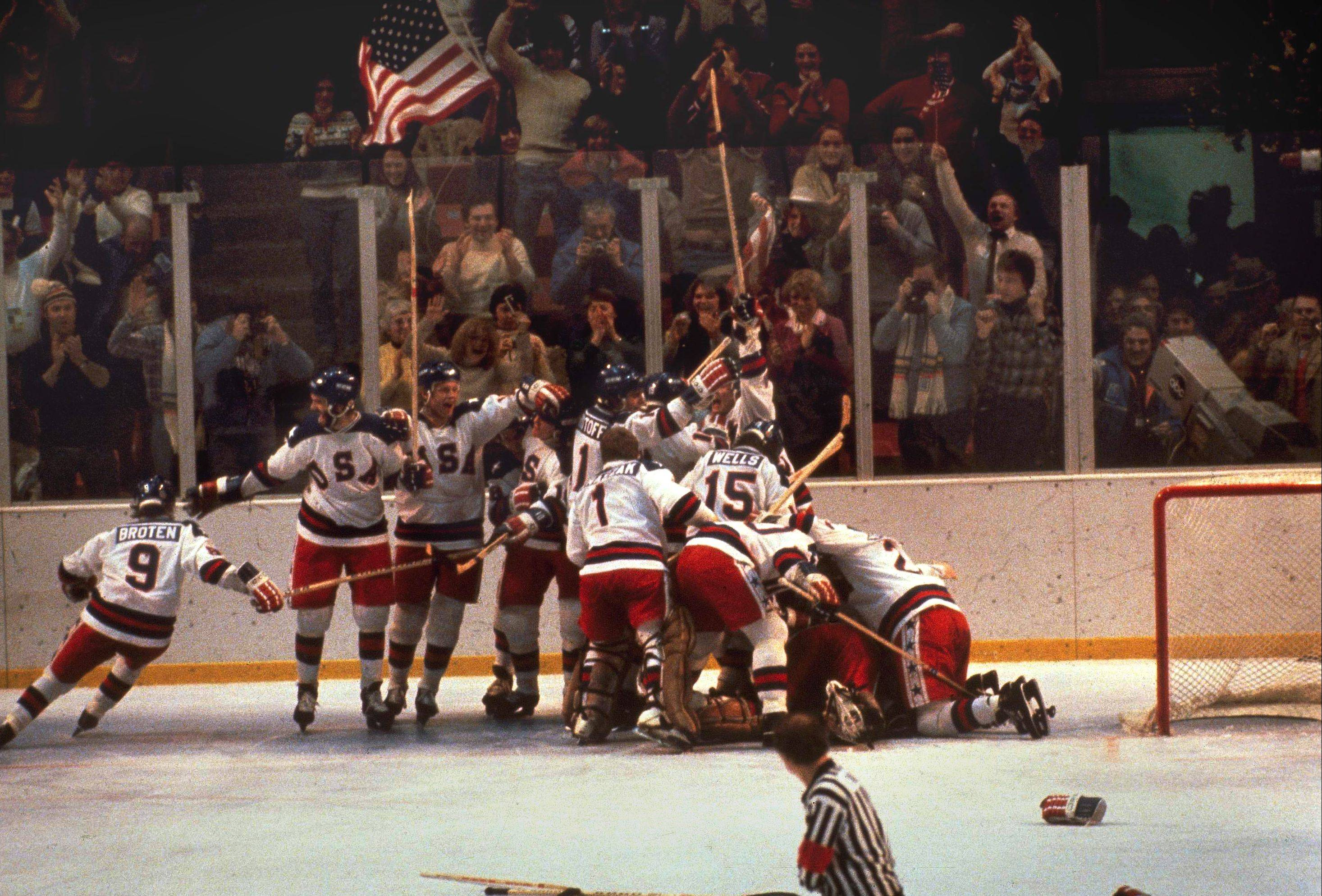 "The U.S. hockey ""Miracle on Ice"" pounces on goalie Jim Craig after a 4-3 victory against the Soviets in the 1980 Olympics."