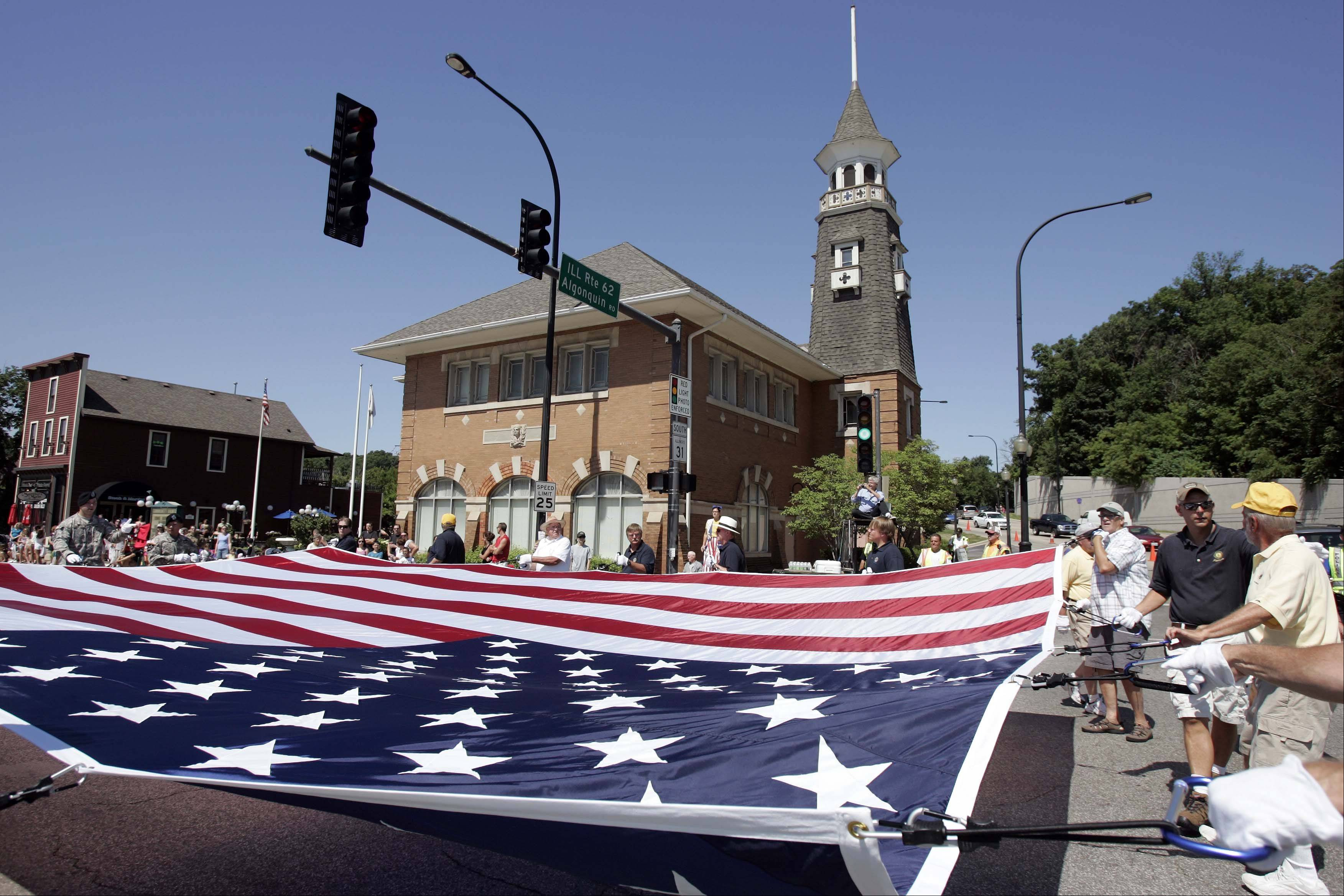 A gigantic flag makes its way South along Route 31 during the parade at last year's Founders' Days Festival in Algonquin.