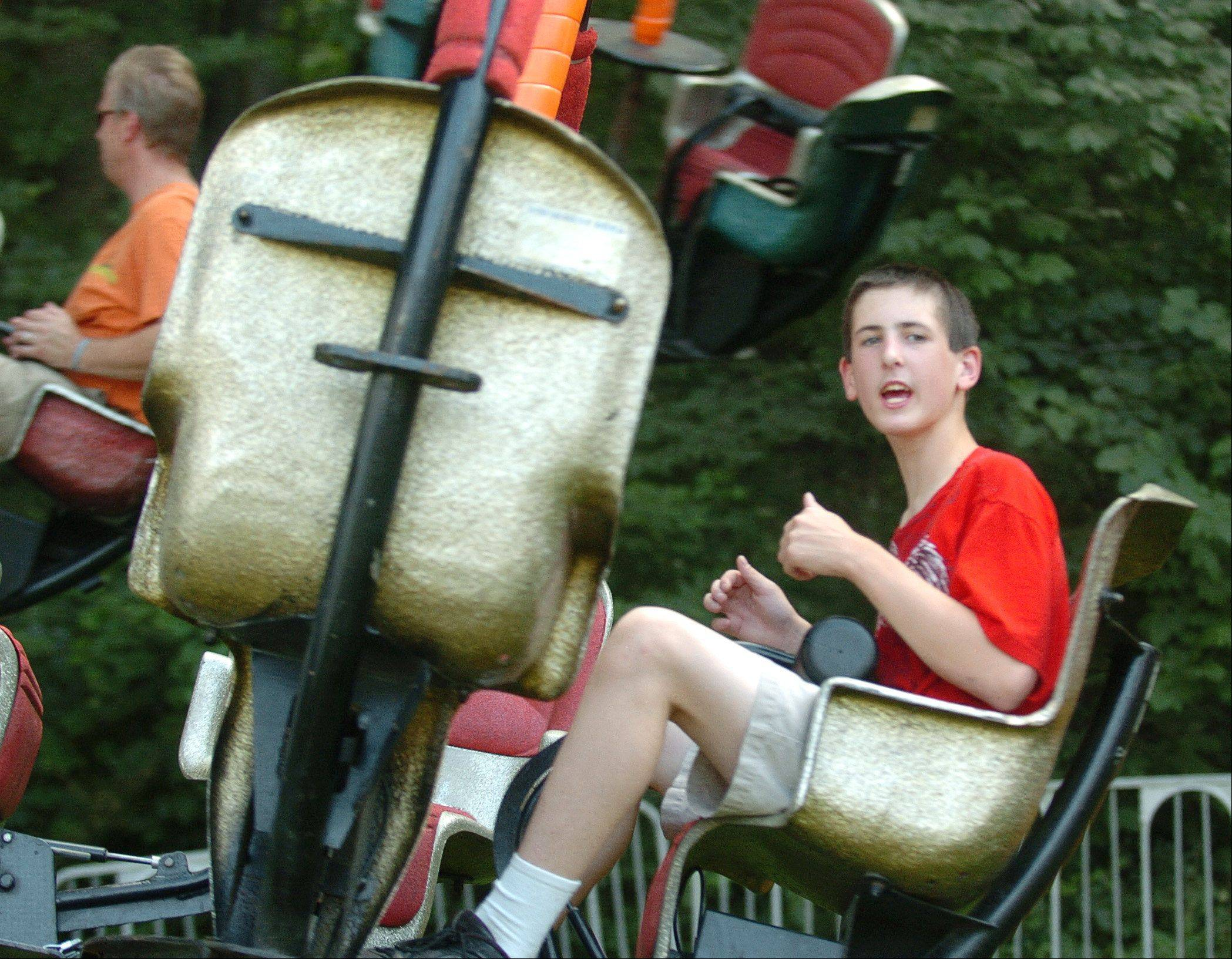 Jonathan Saylor, 15, of Hampshire, enjoys the thrill ride at the carnival for special-needs kids during last year's Algonquin Founders' Days. He attended the carnival with his mom Vicki.