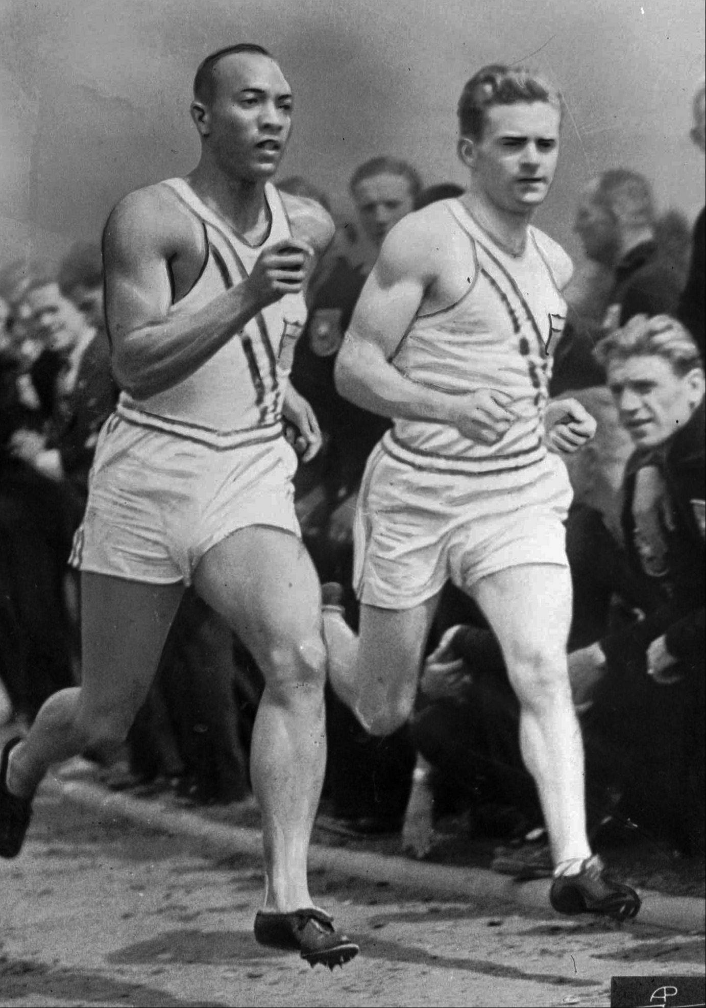 Americans Jesse Owens, left, and Frank Wykoff, right, are shown working out in the Olympic village in Berlin, Germany on Aug. 6, 1936.