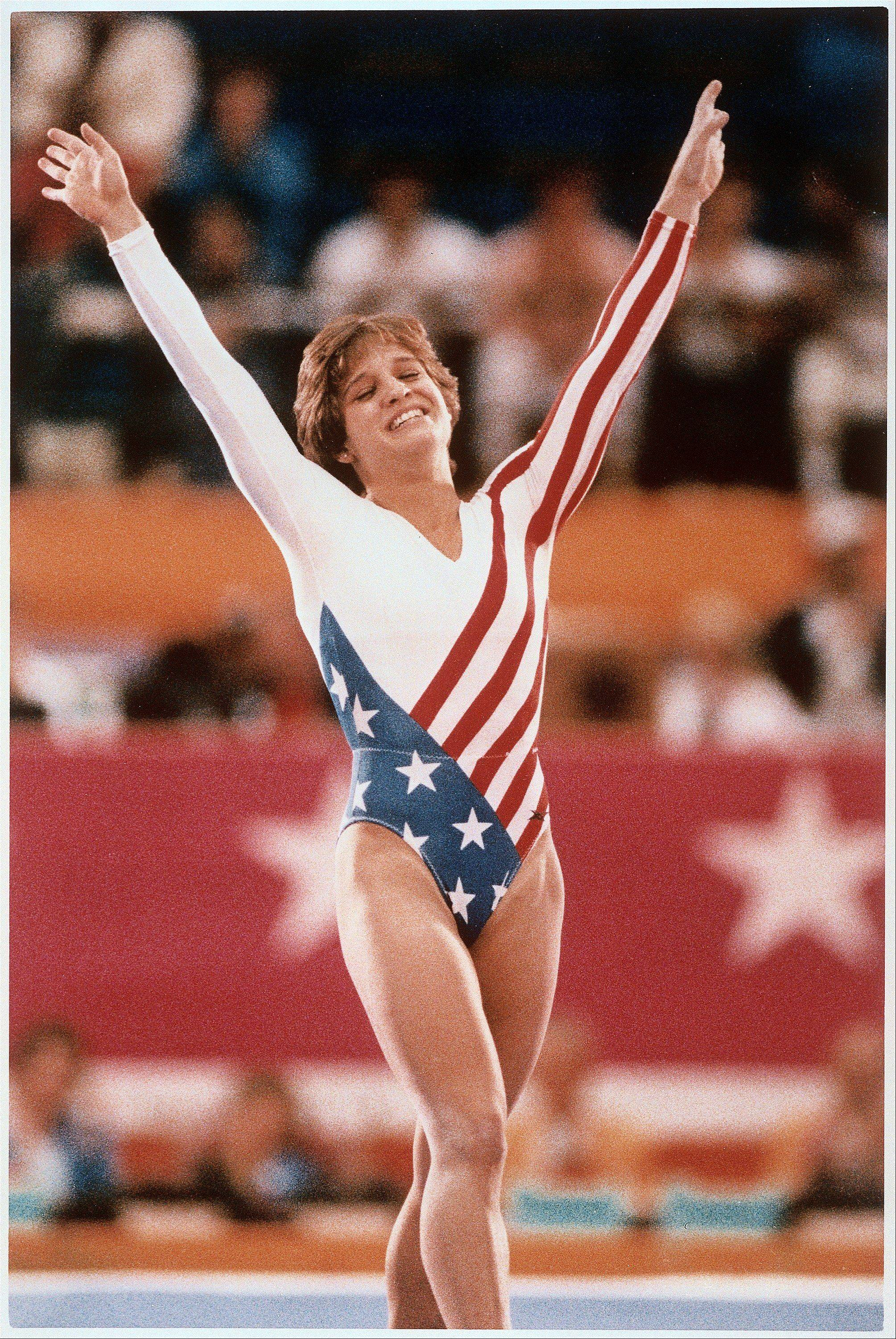 Mary Lou Retton celebrates her balance beam score at the 1984 Olympic Games in Los Angeles on Aug. 3, 1984. Retton, 16, became the first American woman ever to win an individual Olympic gold medal in gymnastics.