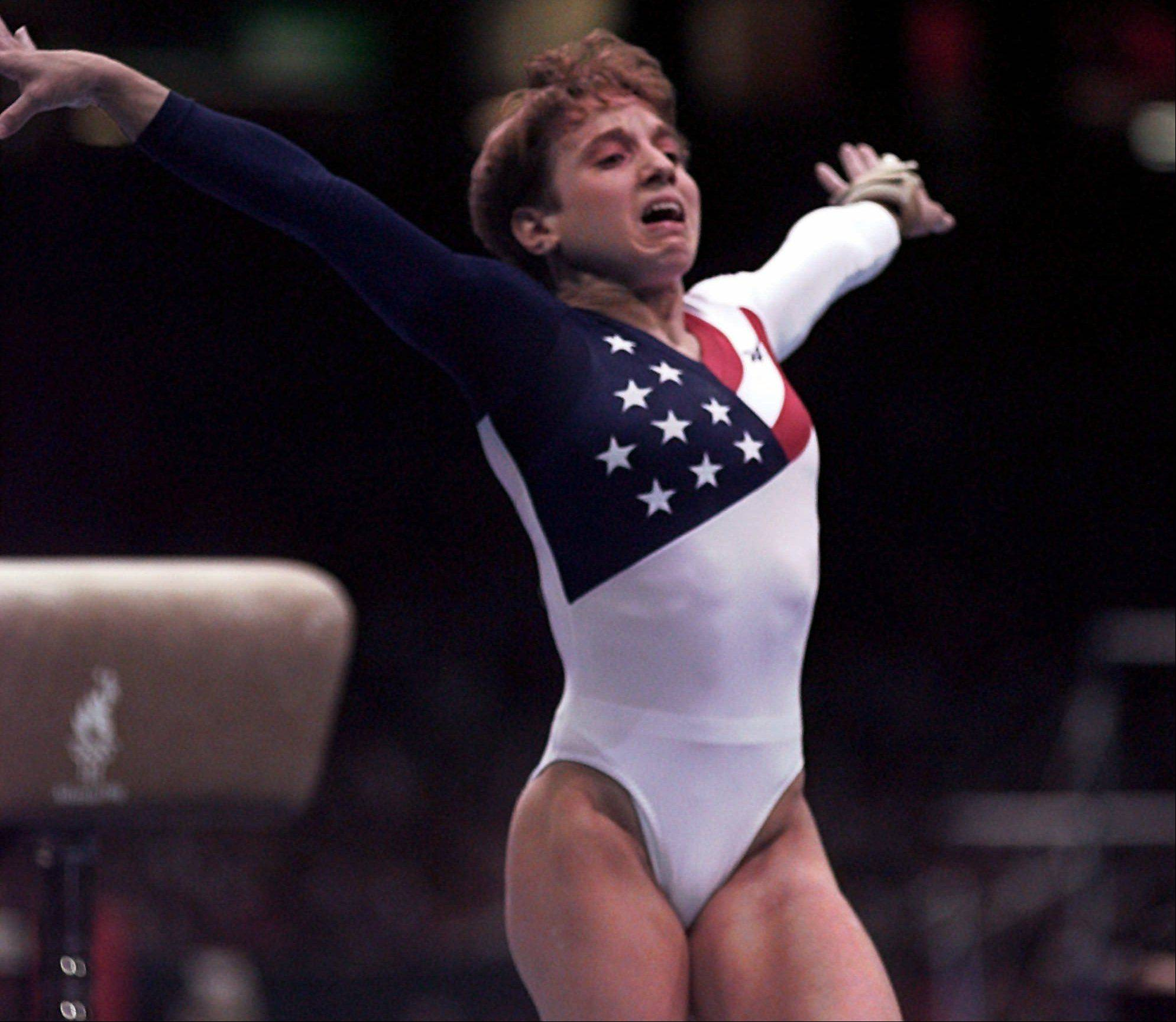 Kerri Strug, of Houston, Texas, reacts after badly landing on her left leg following her vault routine at the women's team gymnastics competition at the Centennial Summer Olympic Games in Atlanta on Tuesday, July 23, 1996.