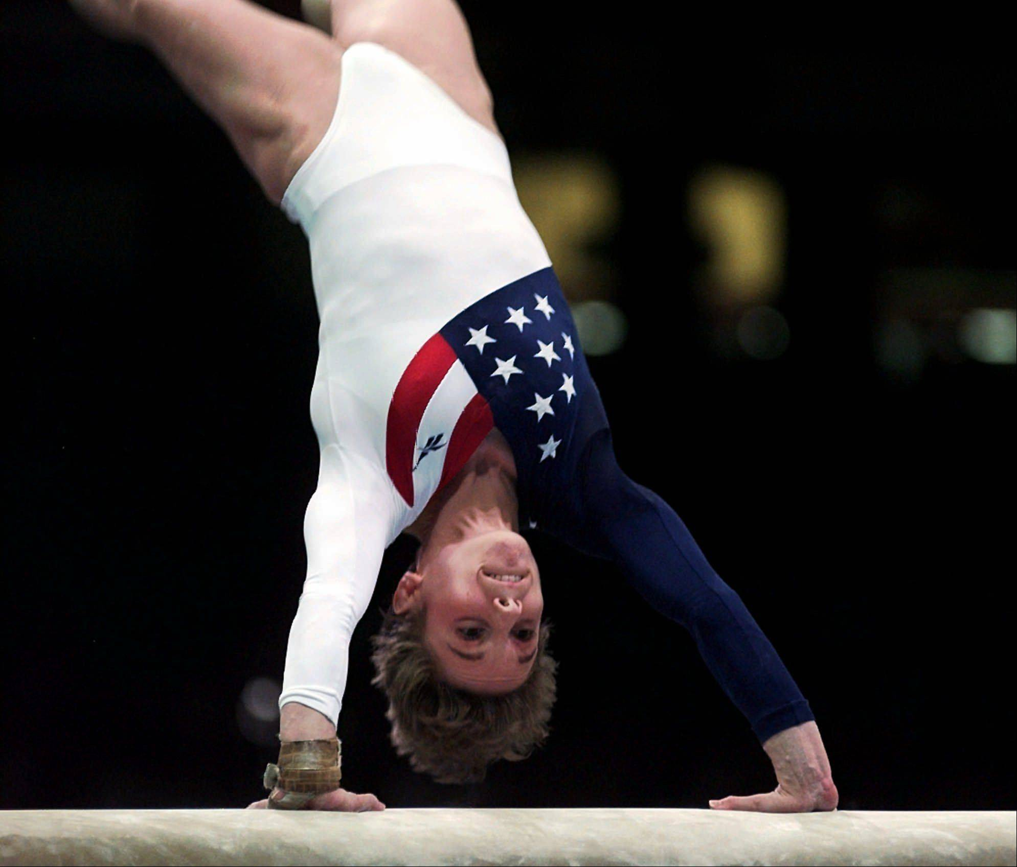 Kerri Strug, of Houston, Texas performs her routine on the vault during the women's team gymnastics competition at the Centennial Summer Olympic Games in Atlanta on Tuesday, July 23, 1996. Strug injured her left leg following this routine.