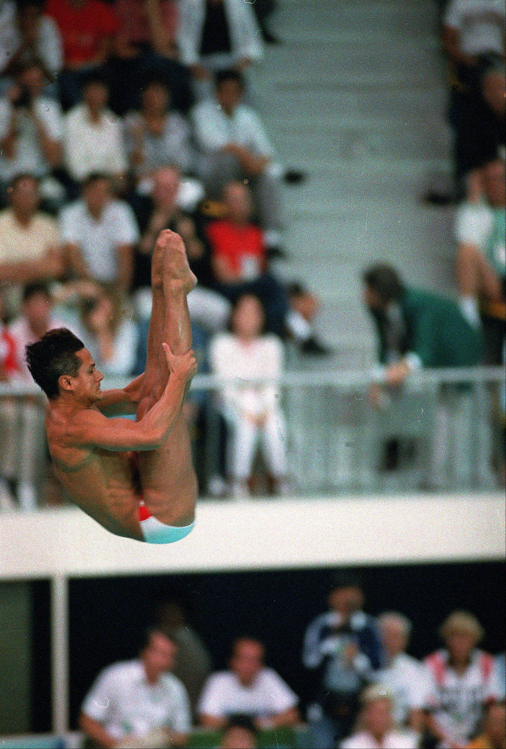 Greg Louganis performs in the men's 10-meter platform diving final competition at the XXIV Summer Olympic Games in Seoul, South Korea on Sept. 27, 1988.