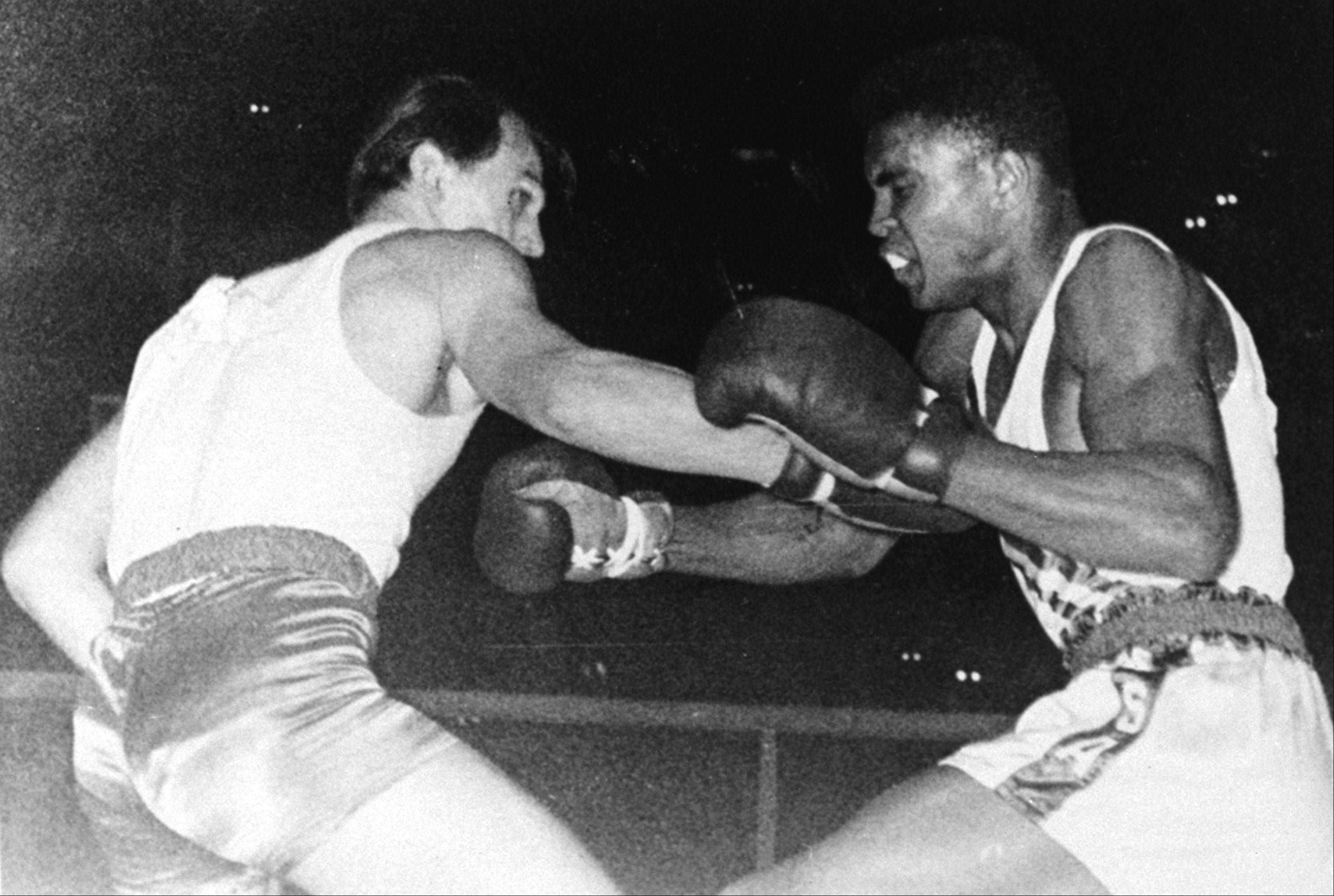 United States Olympic boxer Cassius Clay (Mohammed Ali) of Louisville, KY, right, is shown in action during the Olympic bout against Z. Pietrzykowski of Poland in Rome, Italy, September 5, 1960. Clay outpointed the Pole and won the gold medal in the light heavyweight class for the United States.