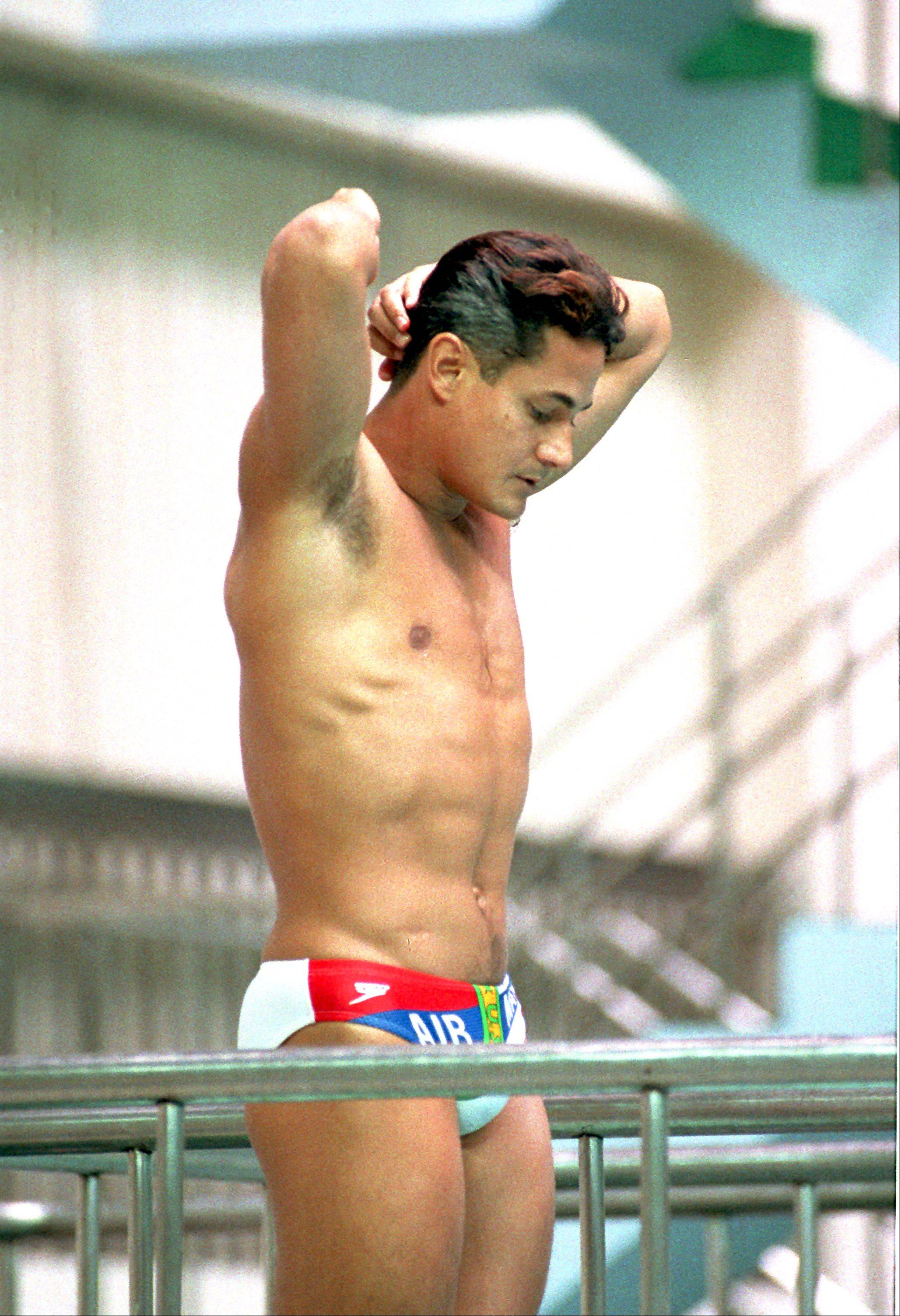 Greg Louganis, U.S.A., pauses momentarily before his 10th dive of the 11-dive preliminary springboard competition during the XXIV Summer Olympic Games in Seoul, South Korea on Sept. 19, 1988. Earlier, the defending champion struck his head on the springboard while competing in the men's preliminary diving event.