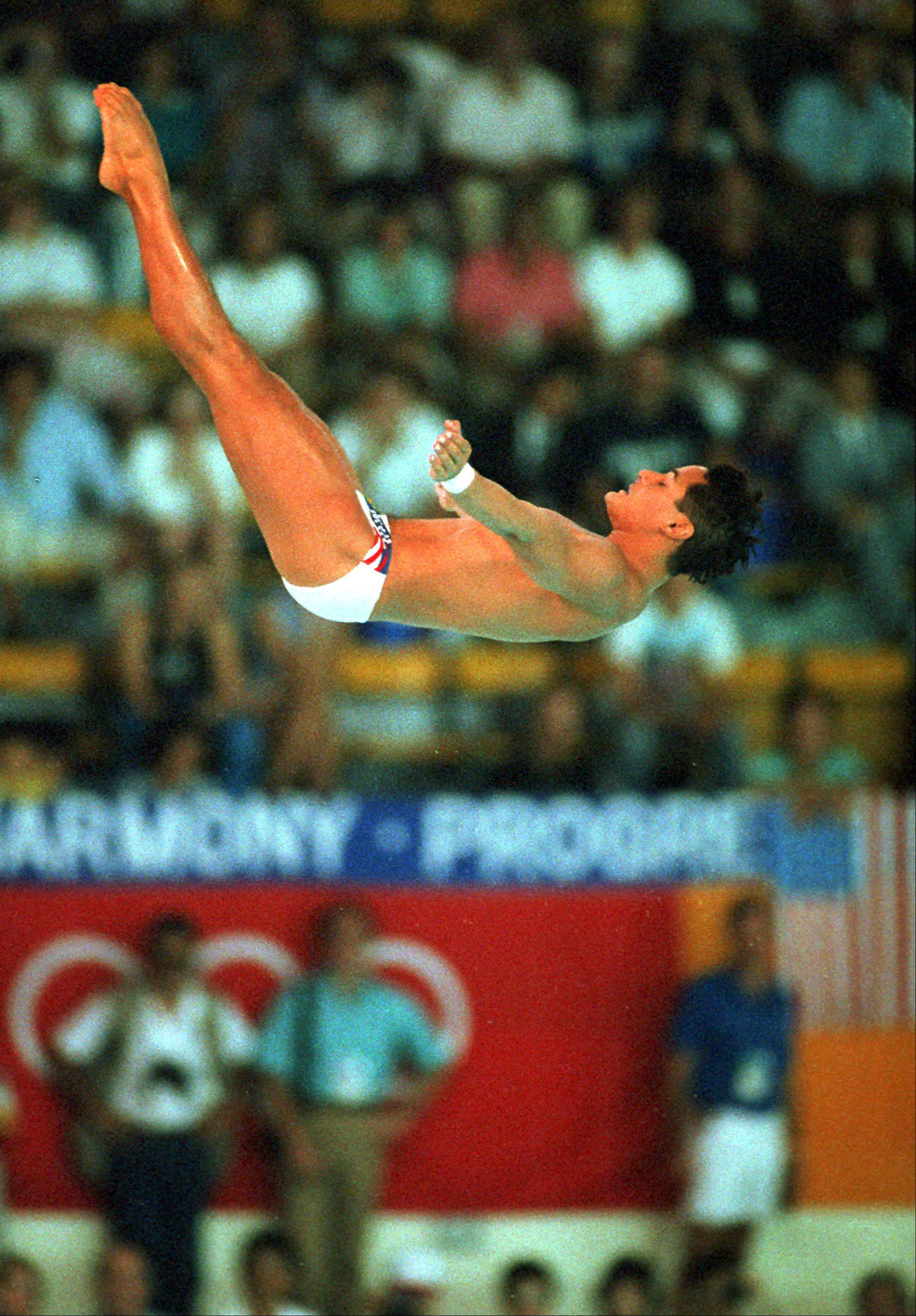 Greg Louganis, of U.S., nails his 10-meter platform diving final at the XXIV Summer Olympic Games in Seoul after hitting his head earlier.