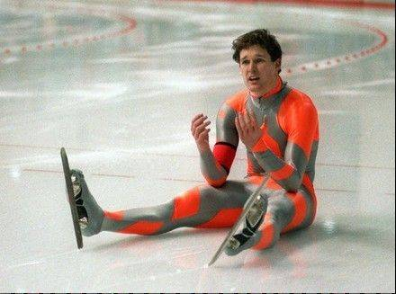 Speed skater Dan Jansen falls, left, during the men's 1,000-meter event at the Winter Olympic Games Feb. 18, 1988, in Calgary. Jansen had learned shortly before taking to the ice that his sister, Jane, had died of leukemia.