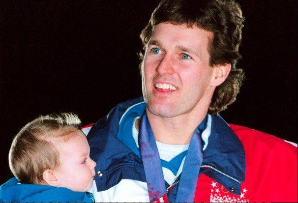 Dan Jansen holds his daughter, Jane, named in his sister's memory, after finally winning gold in 1994.