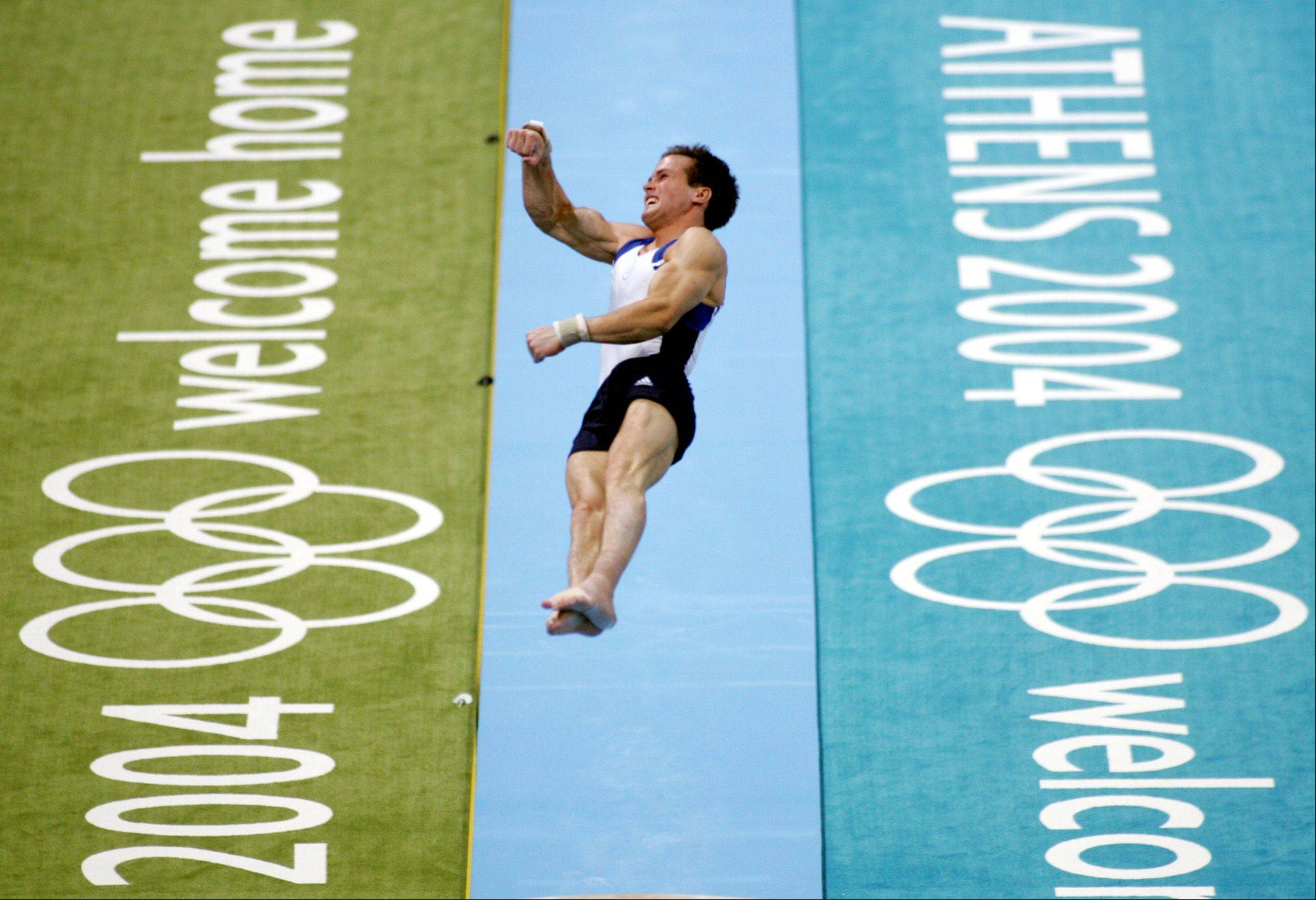 USA's Paul Hamm launches off the vault at the 2004 Olympic Games in Athens.