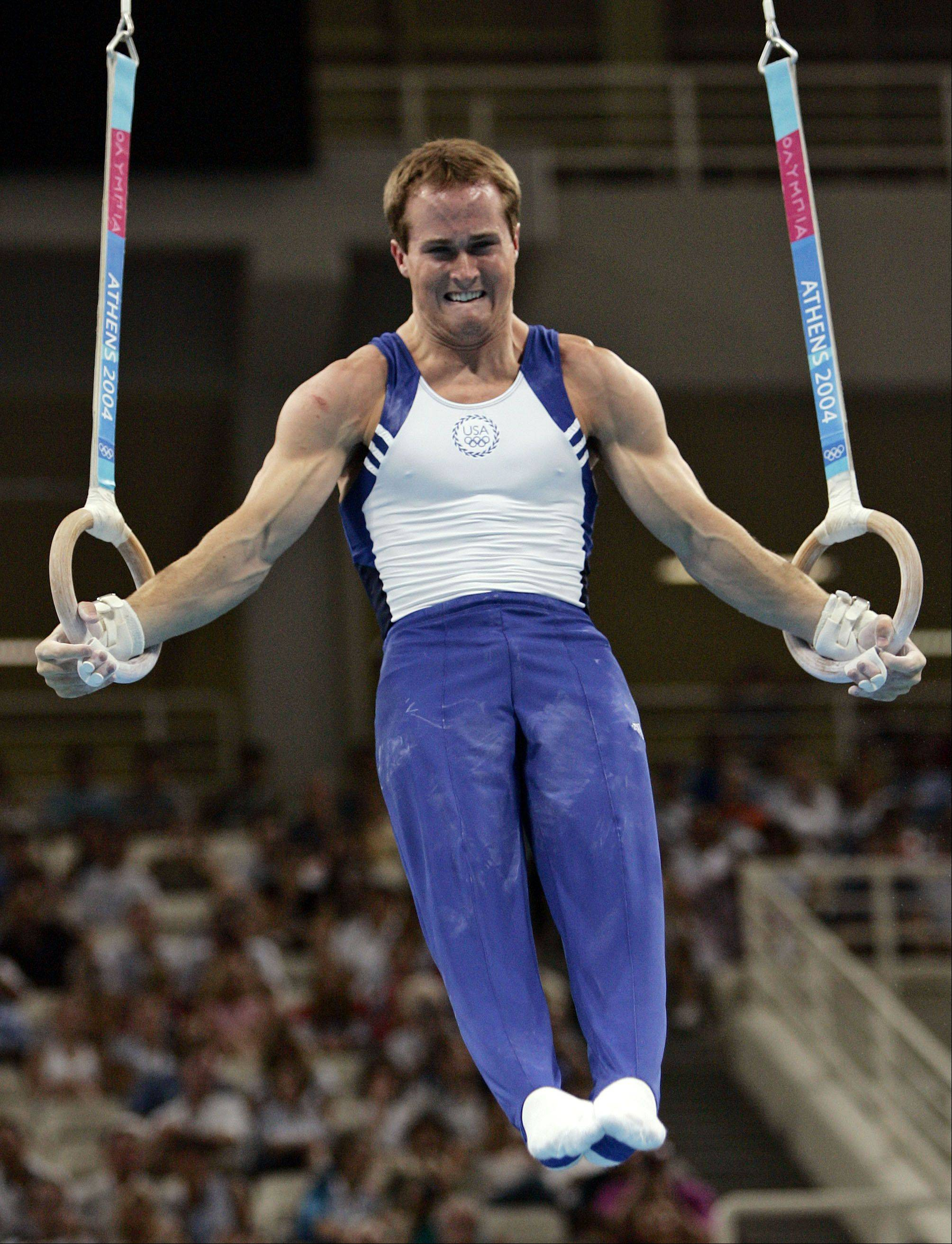 Paul Hamm, of the United States, competes on the rings during the men's gymnastics individual all-around final at the 2004 Olympic Games in Athens in 2004.
