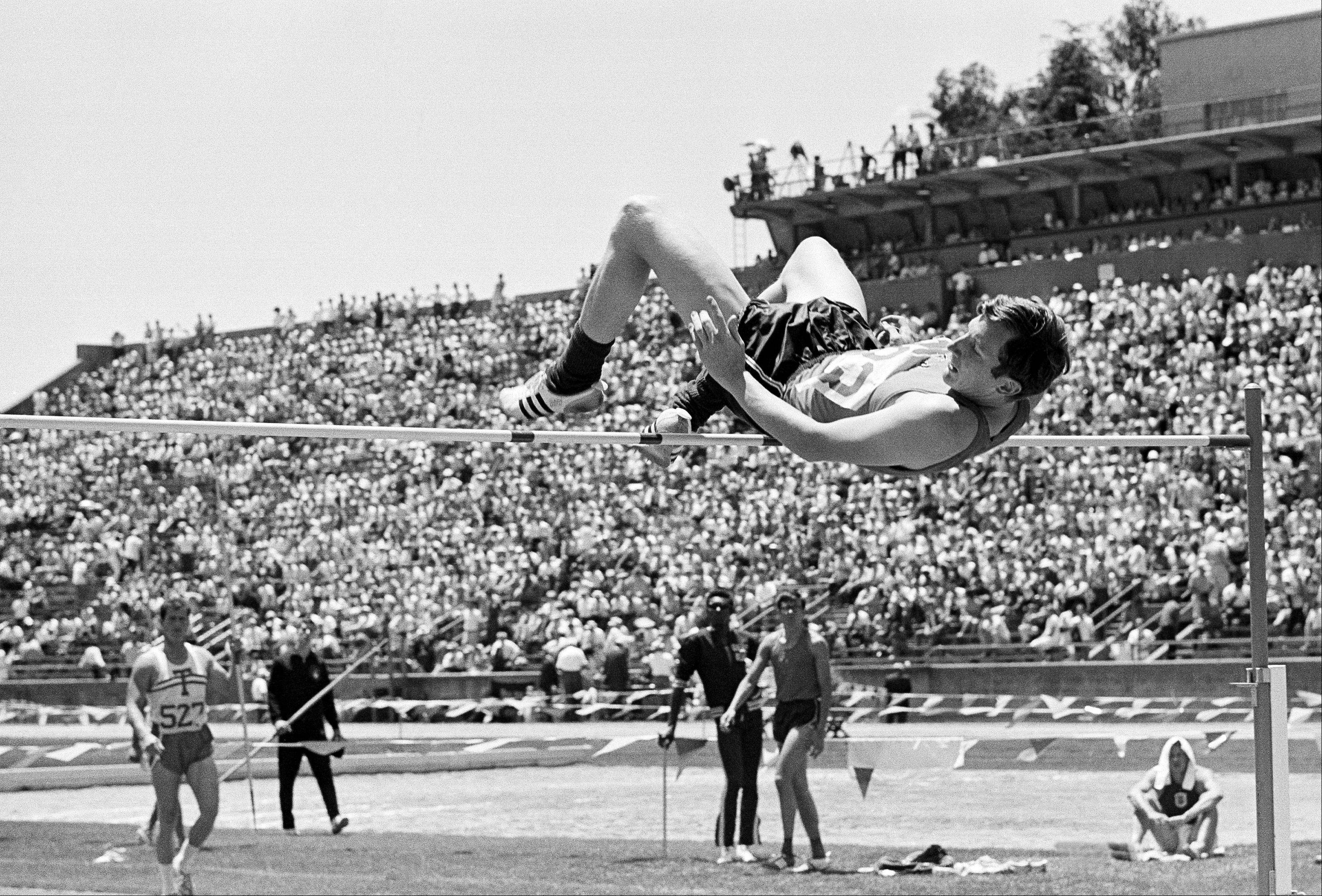 "Dick Fosbury wins gold in the high jump at the 1968 Olympics. His technique, which was coined the ""fosbury flop,"" is now the most common form used in the high jump. Jumpers previously went over the bar face first."