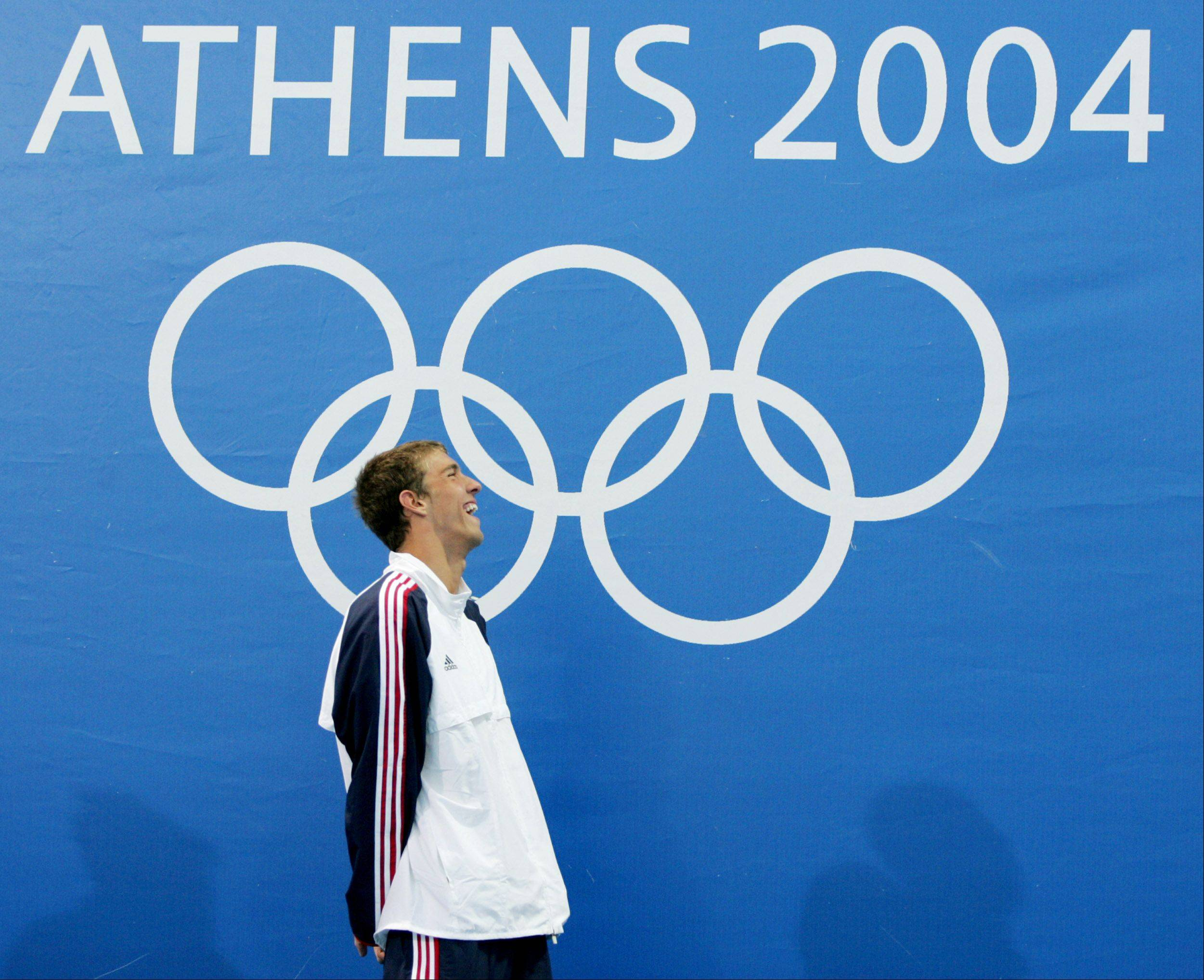 Michael Phelps wins the 400 m individual medley at the Olympic Games Saturday, Aug. 14, 2004 in Athens, Greece.