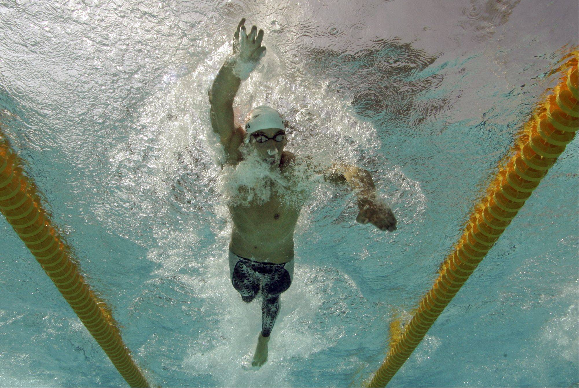 Michael Phelps, of the United States, swims during a qualifying heat of the 200-meter freestyle at the Olympic Aquatic Centre during the 2004 Olympic Games in Athens, Sunday, Aug. 15, 2004.