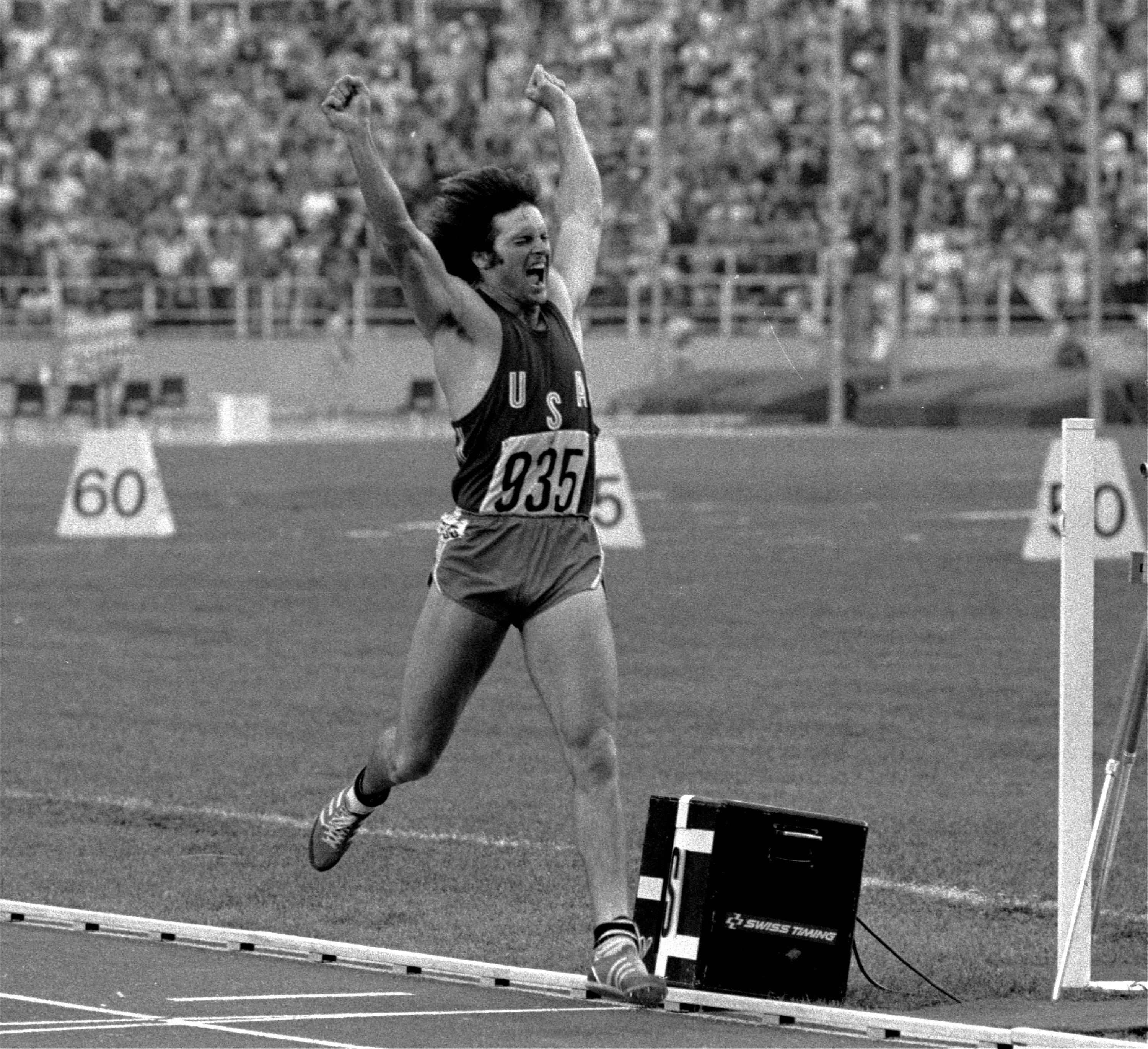 "FILE -- This July 30, 1976 file photo shows athlete Bruce Jenner reacting after securing gold in the Olympic Decathlon in Montreal, Canada. ""Keeping Up With the Kardashians"" family patriarch Bruce Jenner, the 1976 decathlon gold medalist, will head to London to be part of the E! team there later this month. E! became one of NBC Universal's stable of networks a year and a half ago. The company is building a studio for E! so celebrities and athletes can stop by for interviews. Its coverage, anchored by Giuliana Rancic, will be featured on E!'s entertainment newscasts, which run weeknights at 7 p.m. and 11:30 p.m."
