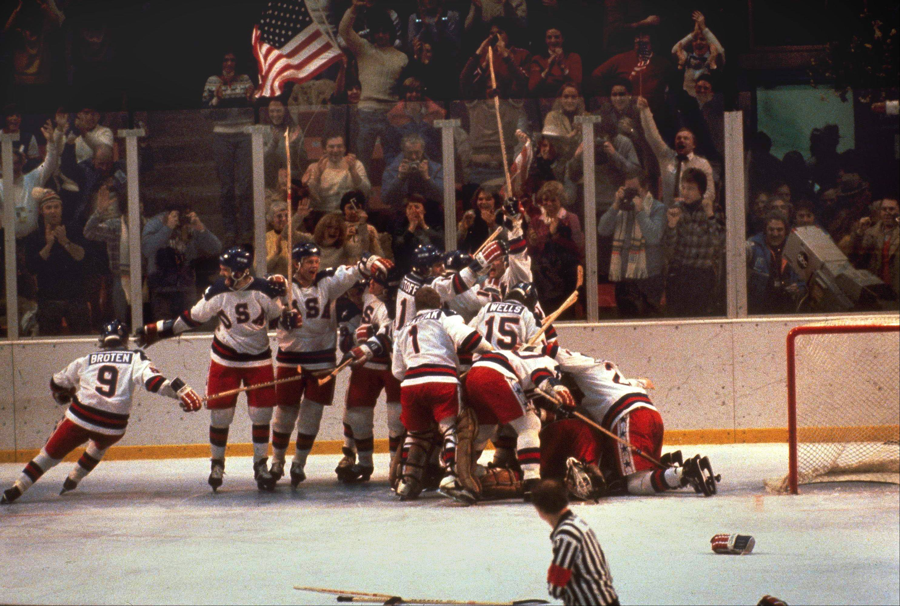 "The ""Miracle on Ice"" U.S. hockey team pounces on goalie Jim Craig after a 4-3 victory against the Soviets in the 1980 Olympics, as a flag waves from the Lake Placid, N.Y. crowd, February 22, 1980."