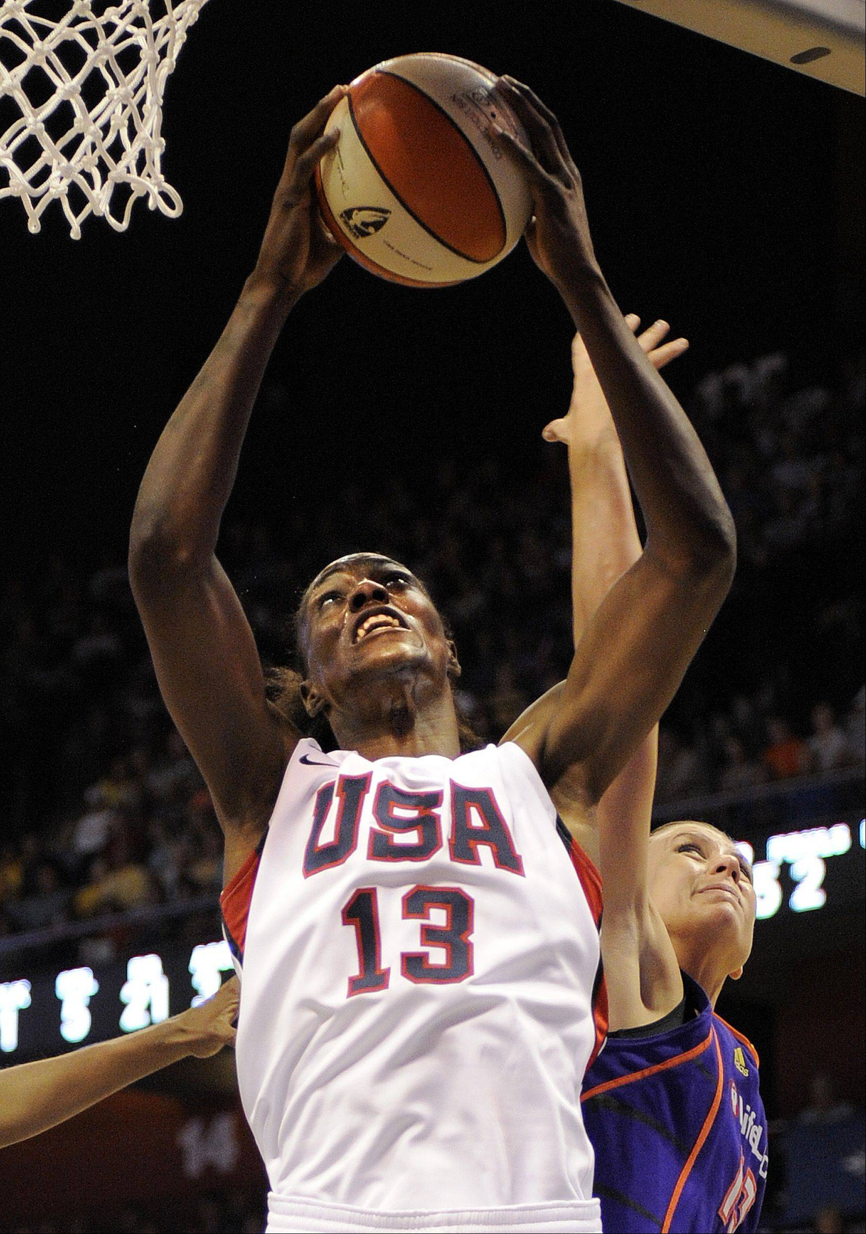 Team USA's Sylvia Fowles grabs a rebound over WNBA All-Stars' Penny Taylor during the second half of the USA's 99-72 victory in their basketball game in Uncasville, Conn., on Saturday, July 10, 2010. Fowles scored a game-high 23 points and had eight rebounds in the game.