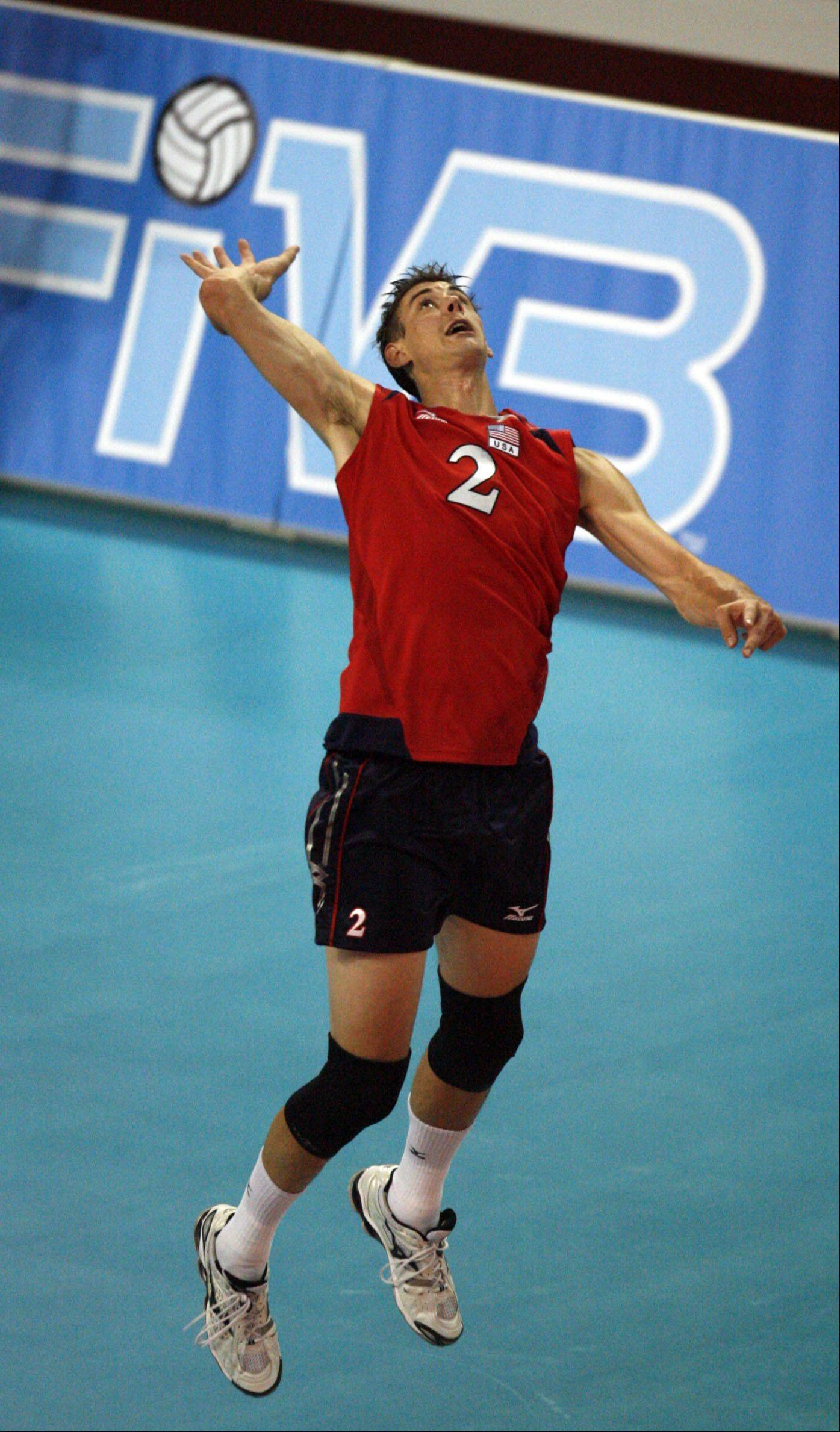 Team USA's Sean Rooney, who attended Wheaton Warrenville South, looks to serve the ball in lost to Finland in the FIVB World League volleyball competition opening match in 3-2 sets at Sears Centre in Hoffman Estates .
