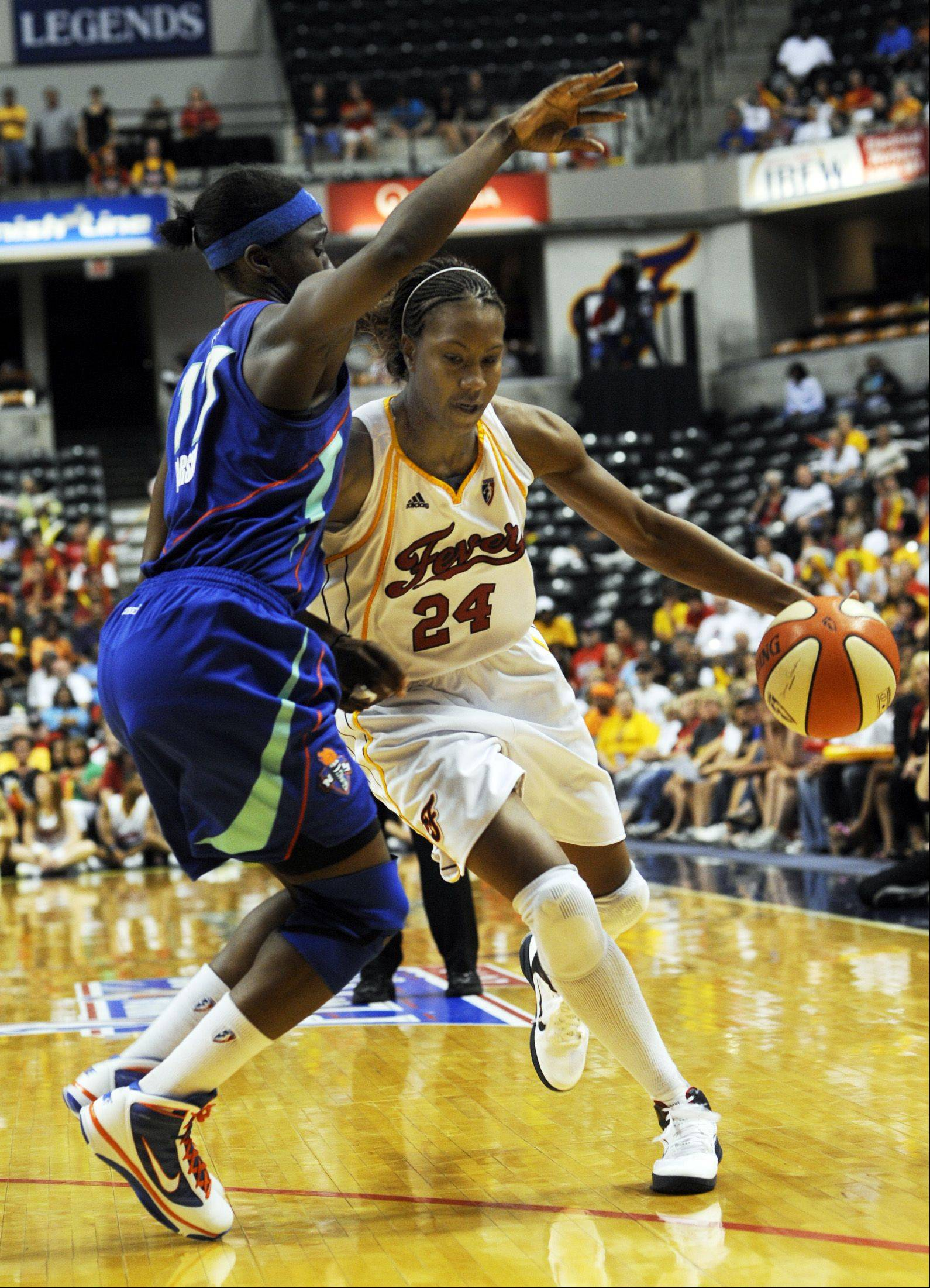 Indiana Fever forward Tamika Catchings, right, drives on New York Liberty forward Essence Carson during the second half of a WNBA Eastern Conference semifinal basketball game in Indianapolis on Sunday, Aug. 29, 2010. Indiana won 75-67. Catchings led Fever scoring with 17.