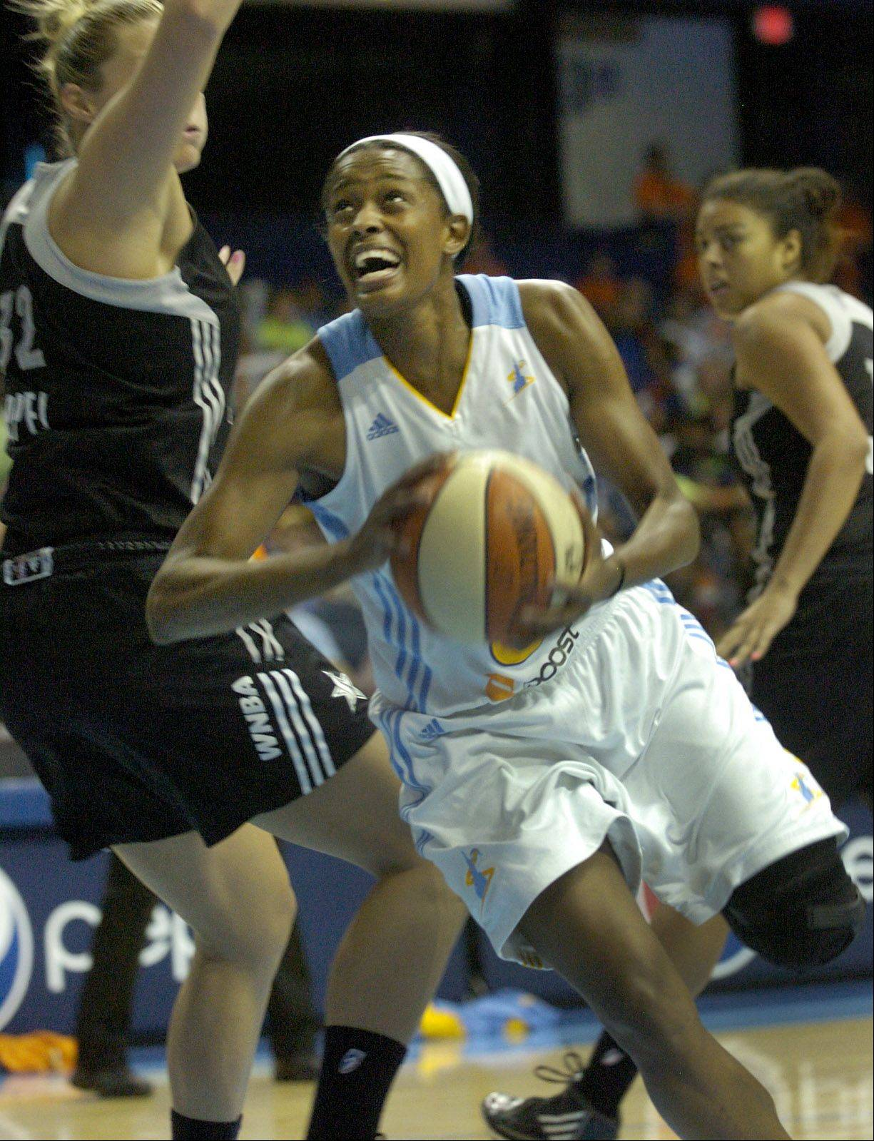 The Sky's Swin Cash drives past San Antonio's Jayne Appel, during Chicago Sky vs. San Antonio Silver Stars WNBA action.