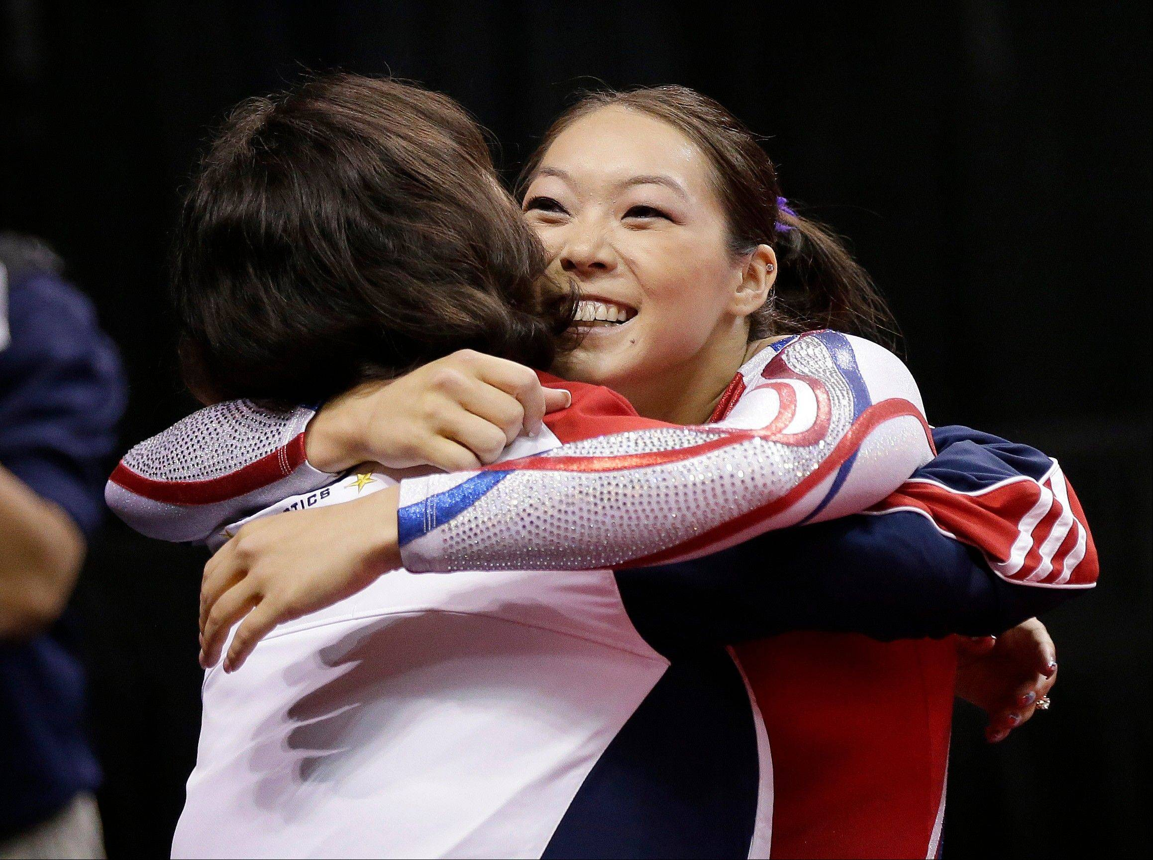 Anna Li hugs her coach after competing on the balance beam during the final round of the women's Olympic gymnastics trials, Sunday, July 1, 2012, in San Jose, Calif. Li was named as an alternate to the U.S. Olympic gymnastics team.