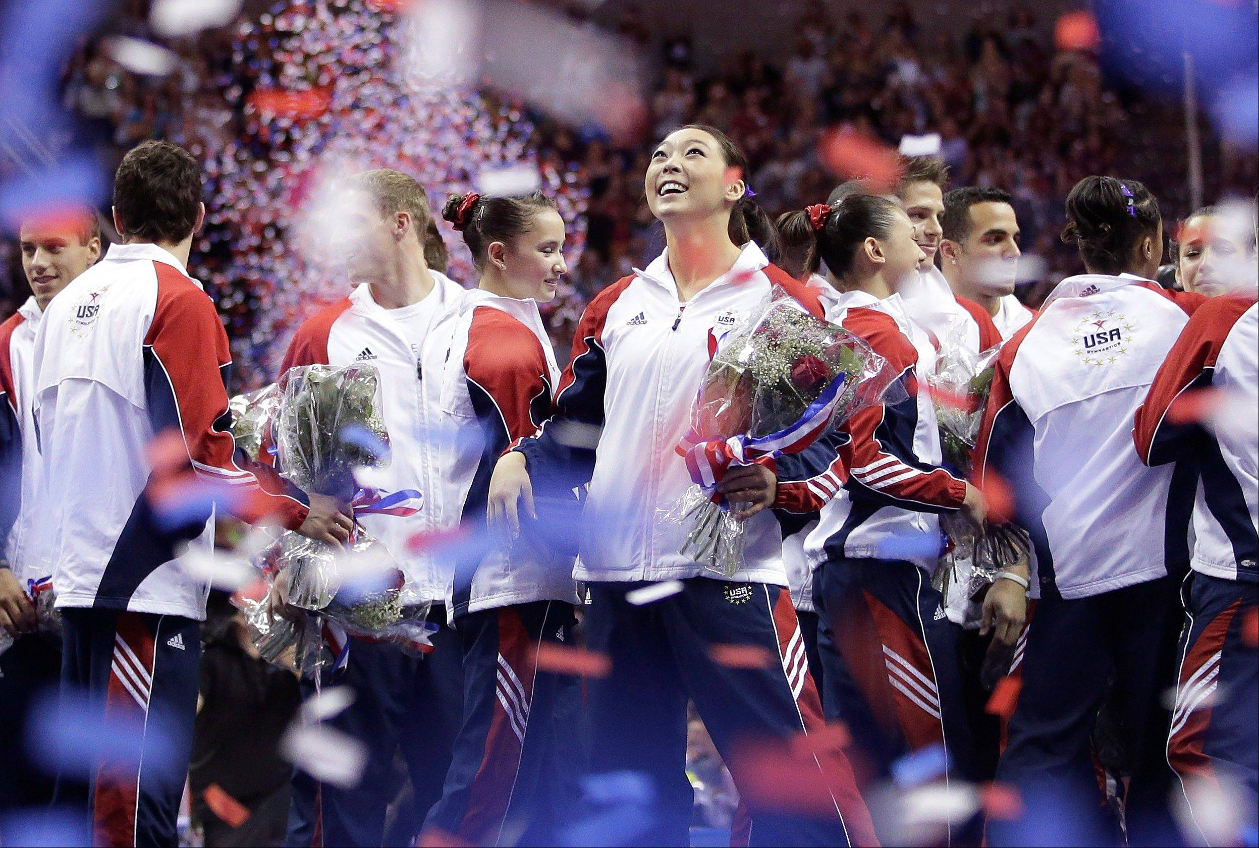 Anna Li reacts as confetti falls after being named as an alternate to the U.S. Olympic gymnastics team after the final round of the women's Olympic gymnastics trials, Sunday, July 1, 2012, in San Jose, Calif.