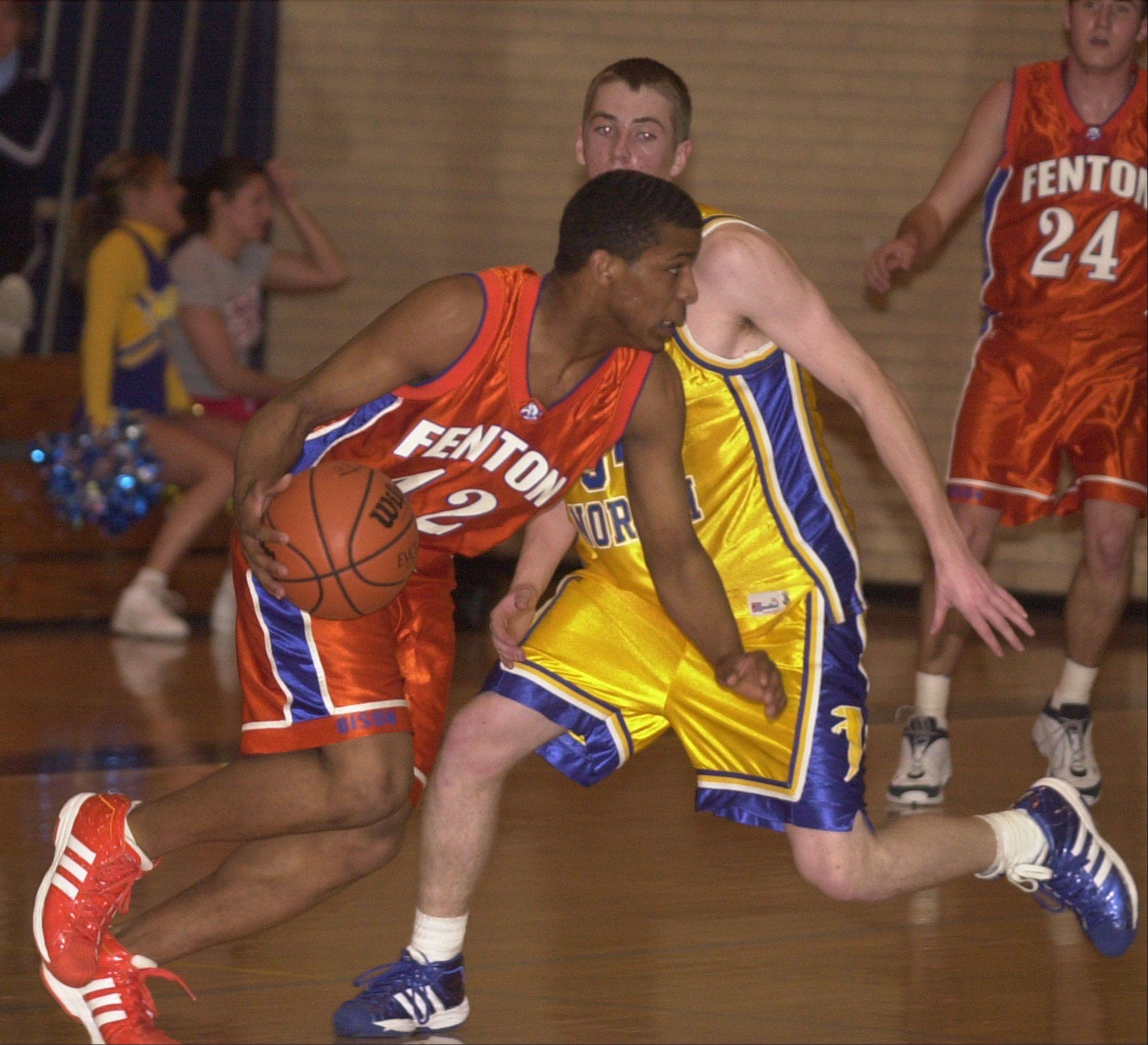 Richard Oruche of Fenton moves the ball against Wheaton North in 2004. Oruche will compete with Nigeria in the 2012 London games.