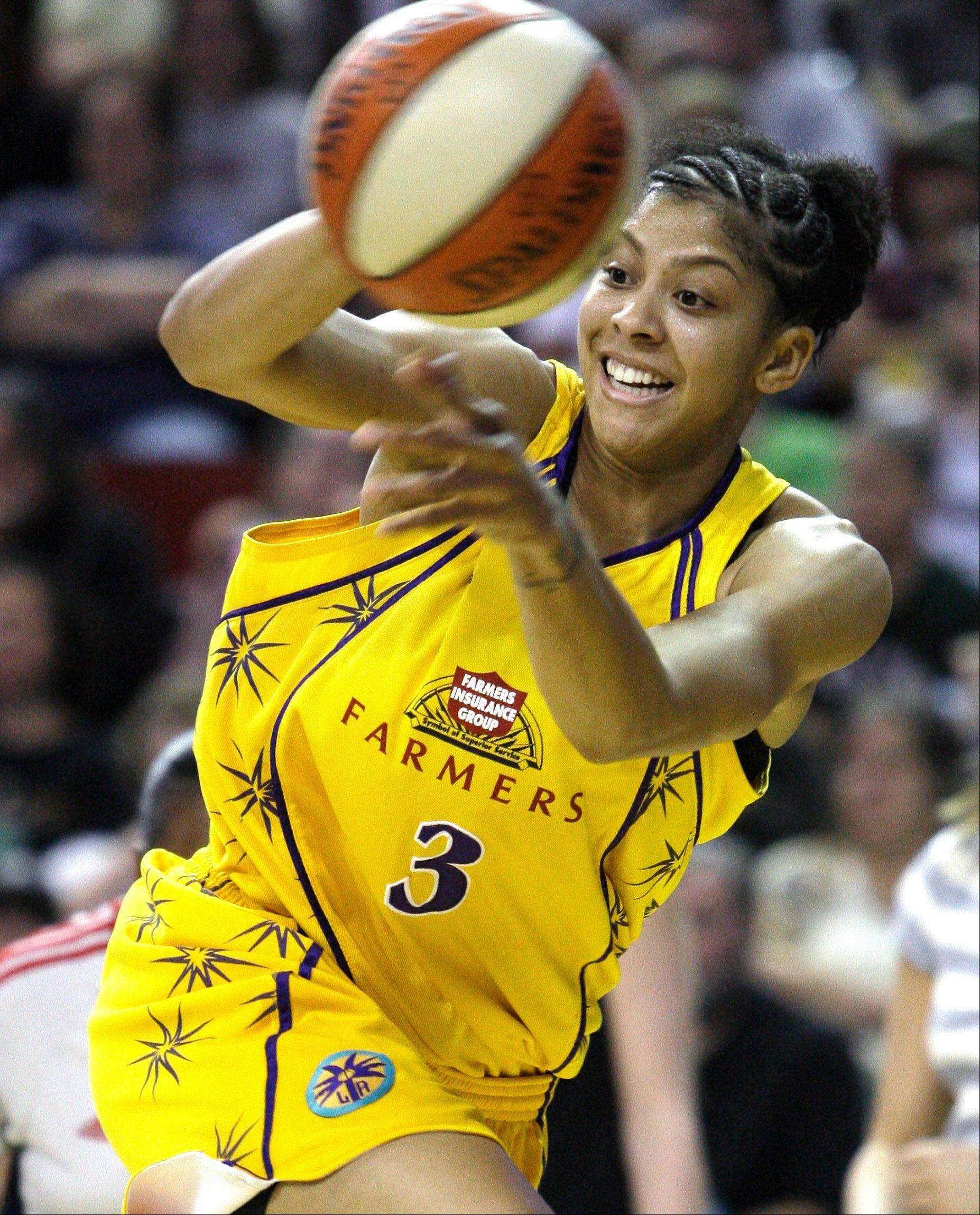 In this Sept. 20, 2009, file photo, Los Angeles Sparks' Candace Parker leaps out of bounds to try to save an errant pass against the Seattle Storm during the first quarter in Game 3 of a WNBA first-round basketball series, in Seattle.