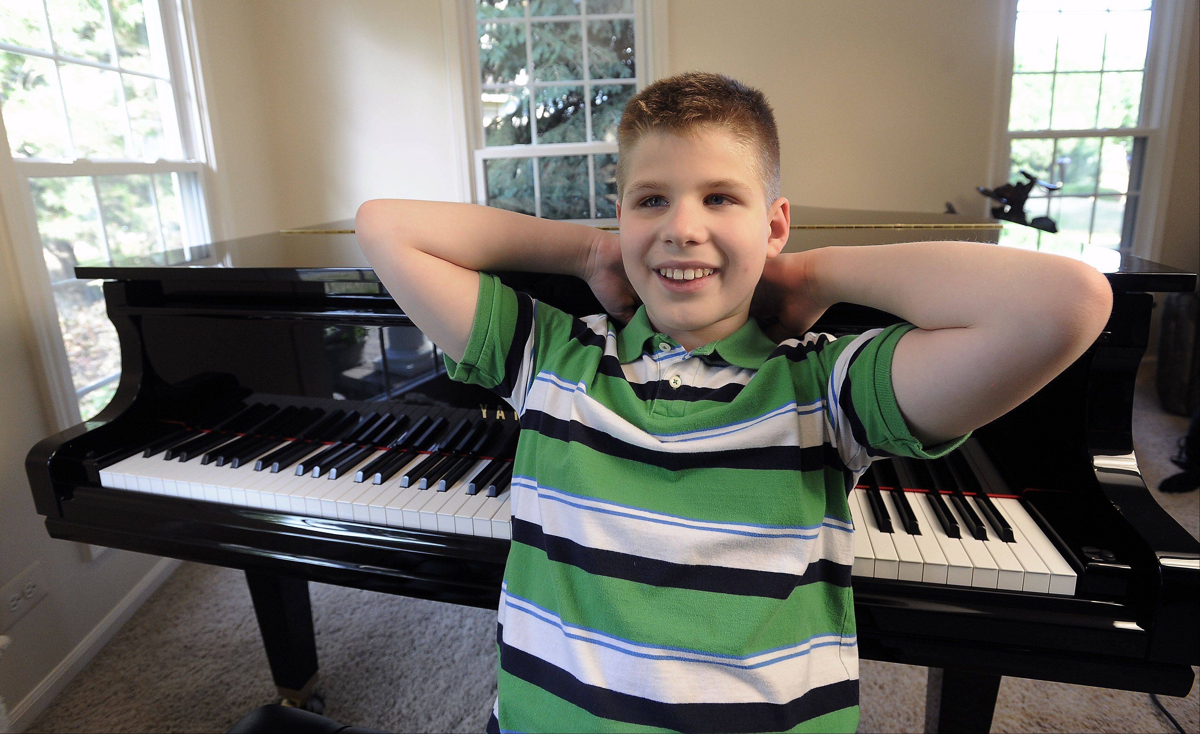 Elk Grove Village 12-year-old Jack Falejczyk doesn't let his blindness stop him from playing piano and violin, swimming competitively and getting straight A's.