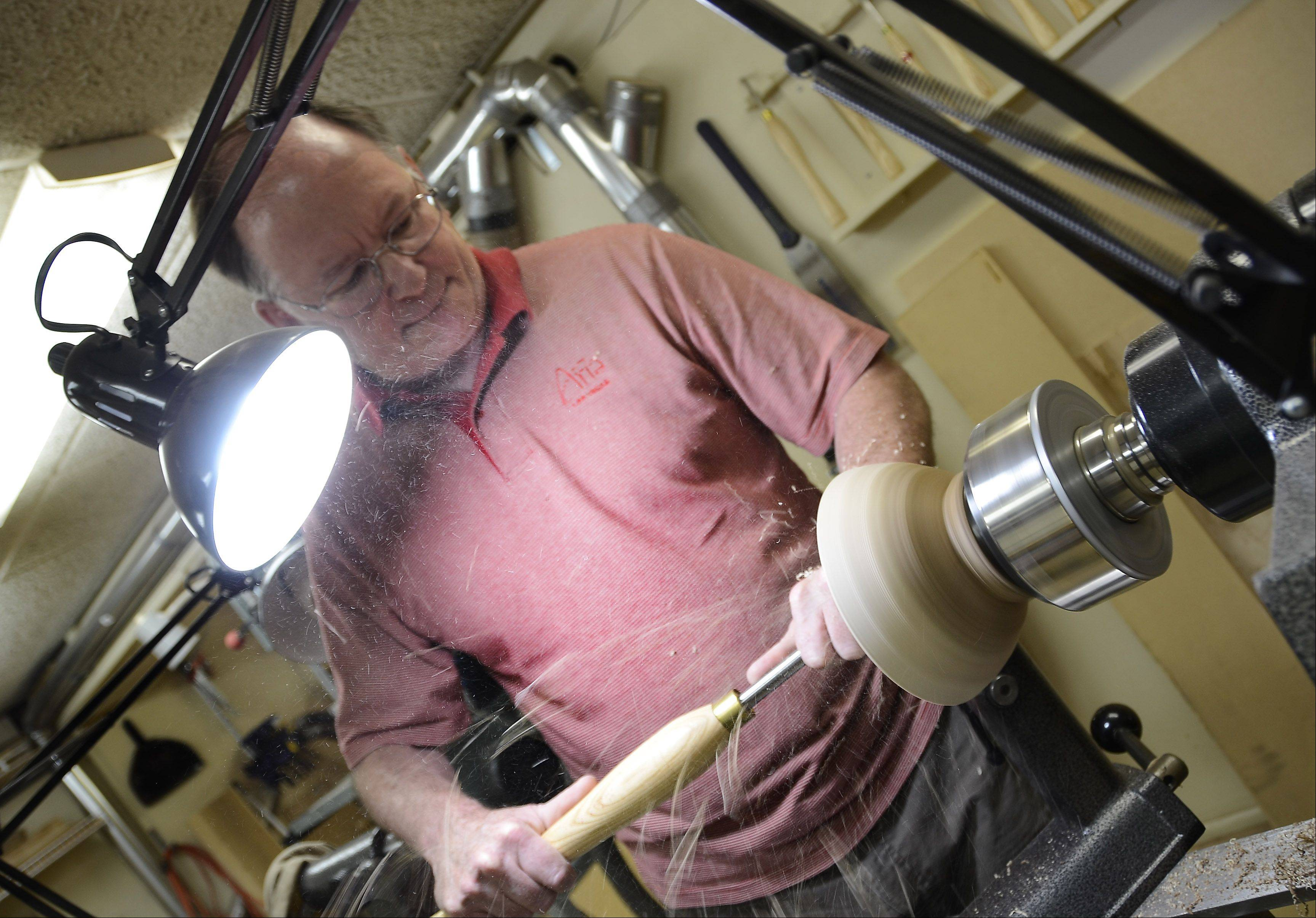 "Al Miotke of Mount Prospect turns a bowl on the lathe in his wood shop. He and other woodturning experts will host seminars at ""Turn-On! Chicago 2012,"" a three-day symposium coming Aug. 3-5 to Mundelein."
