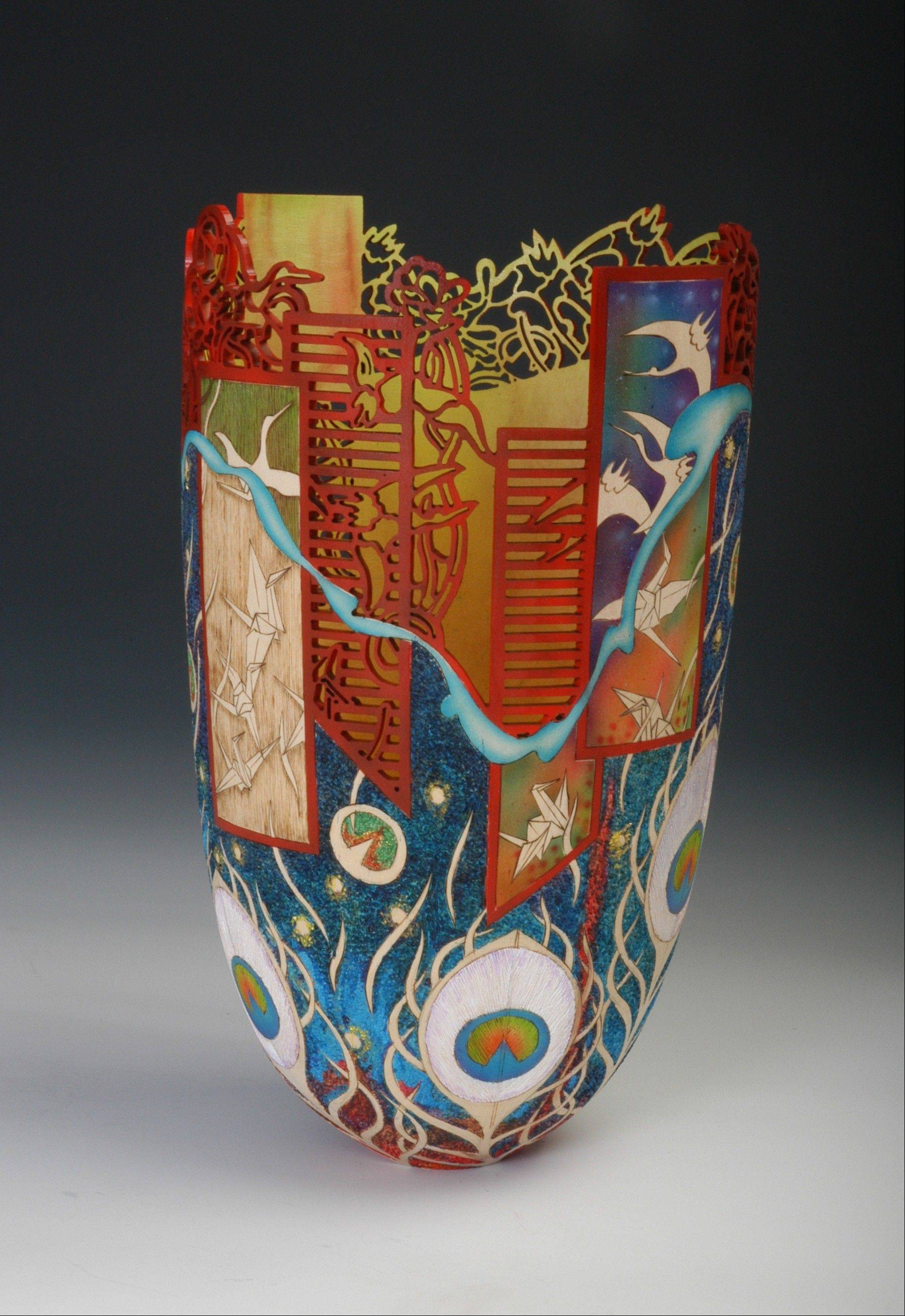 Courtesy of Binh PhoWhile woodturning can be used to make a simple vase, acclaimed artist Binh Pho of Maple Park turns wood into works of art such as this.