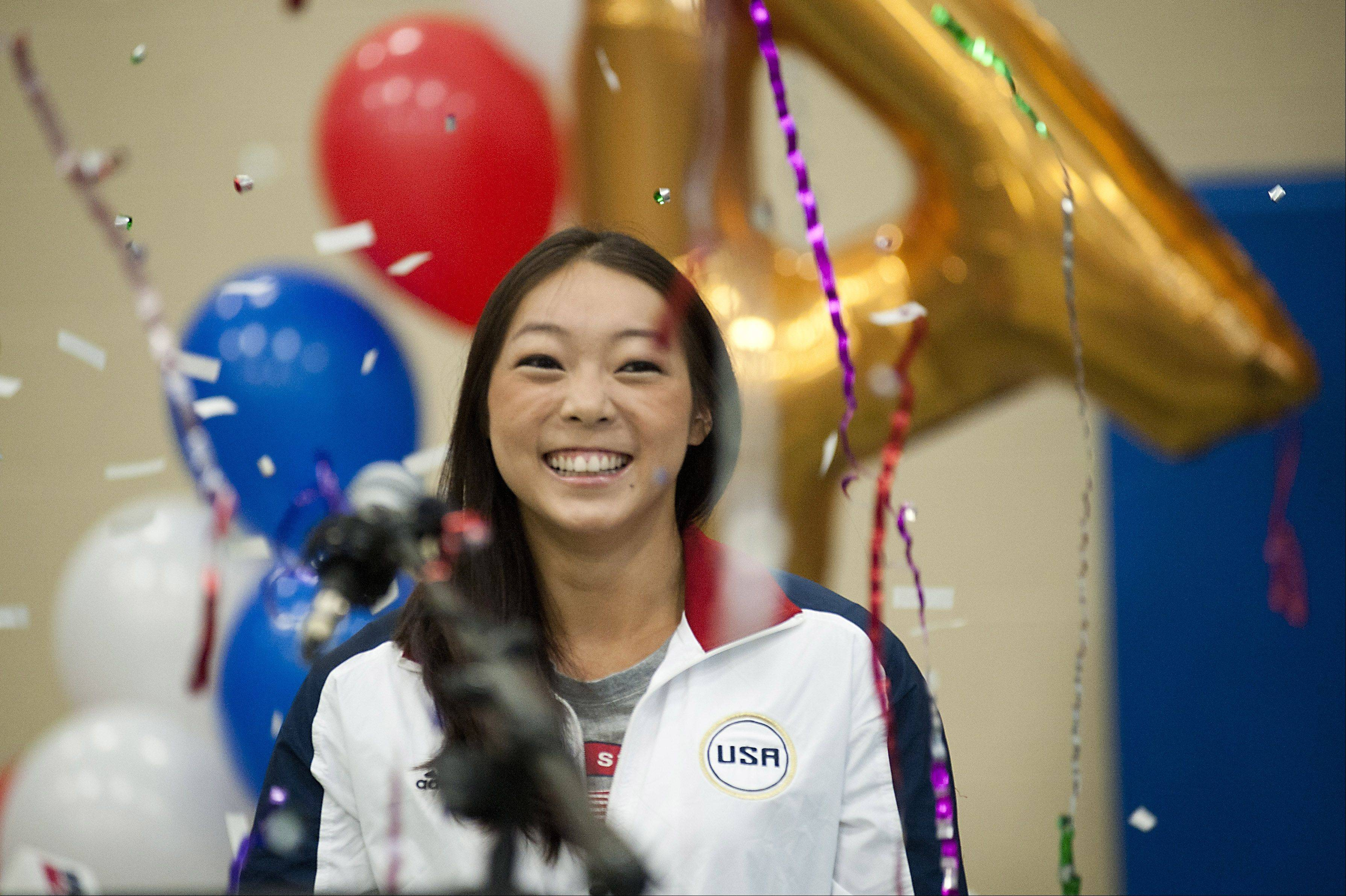 Aurora gymnast Anna Li was showered with cheers and confetti in her hometown before she left for the Olympic Games in London. Li, a Waubonsie Valley graduate, was chosen as an alternate member of the U.S. Women's Gymnastics Team, but a neck injury has forced her out of competition.