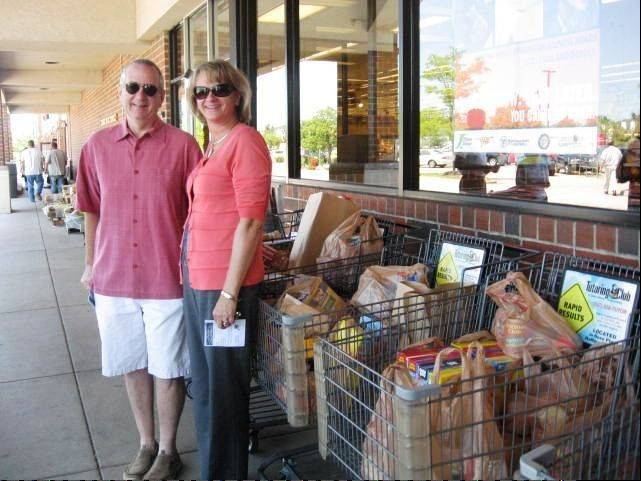 RAH member Maria Radwan and a donator stand next to food collected at a local supermarket on July 13.
