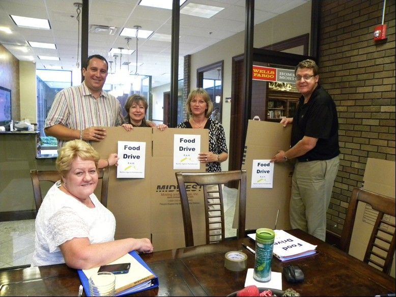 RAH members construct boxes to collect food for the initiative. From left, Sue Gould, Basel Tarabein, Gail Bergstrom, Maria Radwan and Marty Eich.