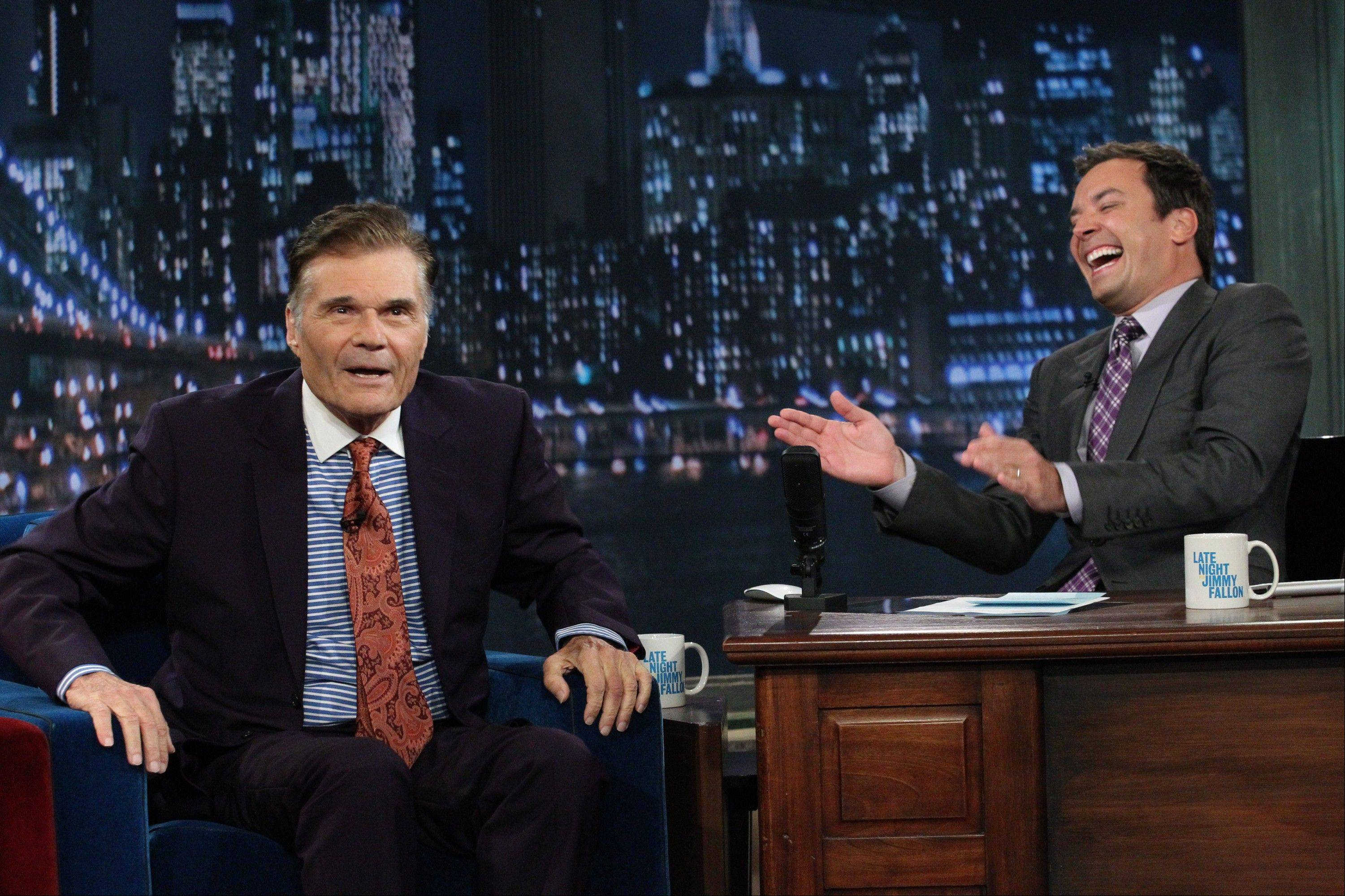 "Fred Willard, left, joked around with host Jimmy Fallon on the set of Fallon's NBC show ""Late Night"" in an effort at damage control."